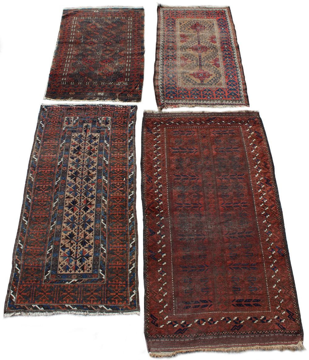 Lot 41 - Property of a deceased estate - four early 20th century Belouch rugs including a prayer rug, the