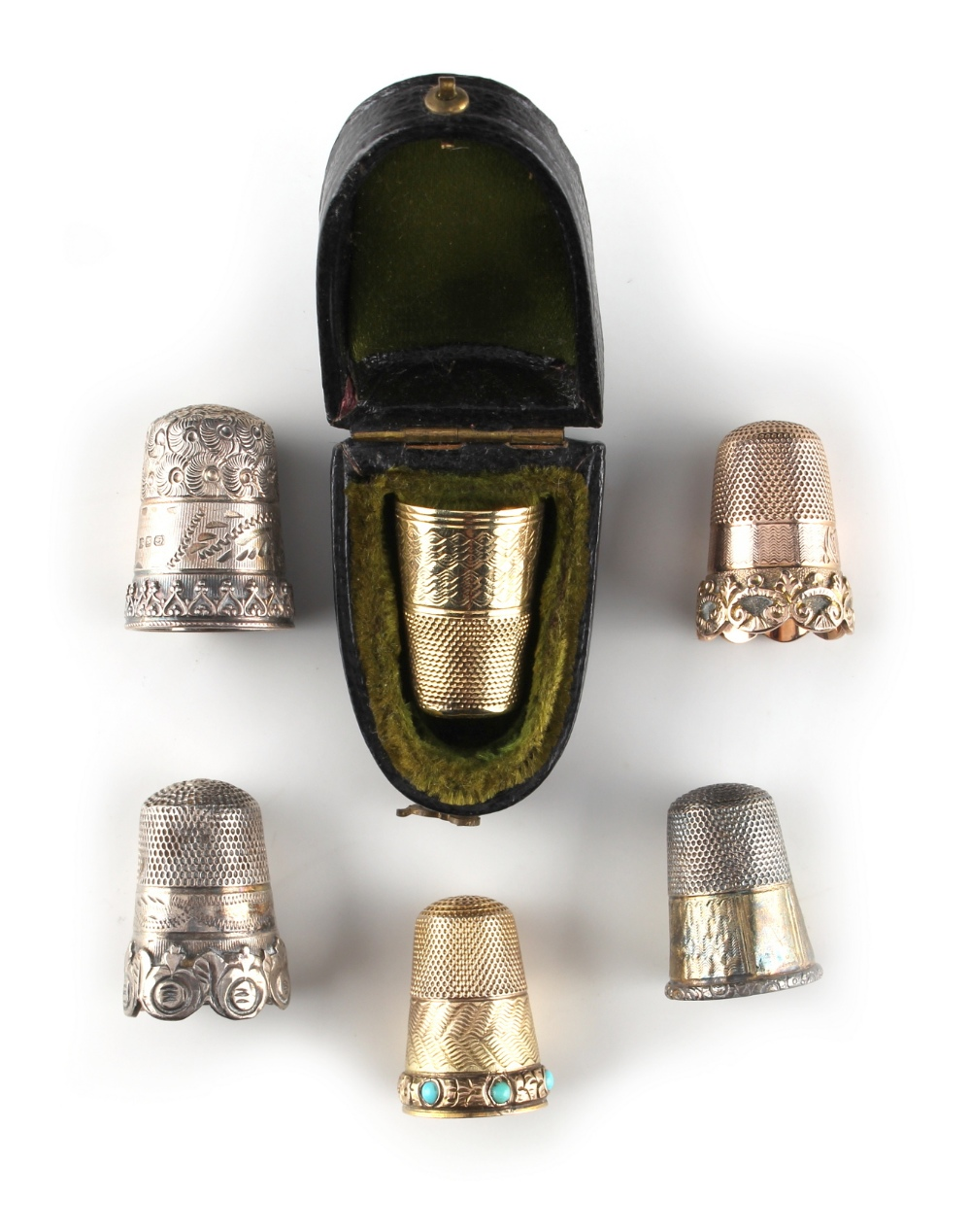 Lot 36 - Property of a lady - a cased yellow metal thimble; together with two further yellow metal