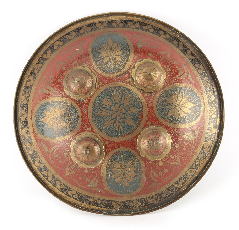 Lot 14 - Property of a gentleman - a late 19th century Indian brass small shield, dhal, with four