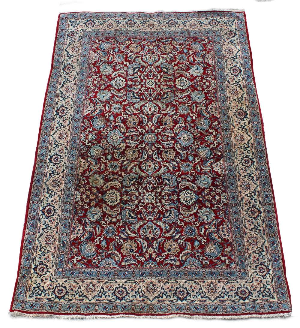 Lot 43 - Property of a deceased estate - a Kashan rug, with burgundy field, approximately 87 by 57ins. (222