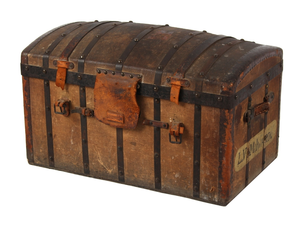 Lot 31 - Property of a lady - a late 19th / early 20th century metalbound canvas domed trunk, with interior