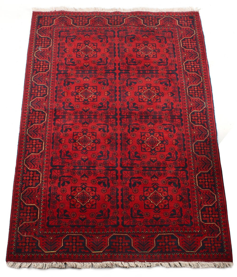 Lot 59 - Property of a gentleman - a modern Turkoman design hand-knotted wool rug, with burgundy ground, 73