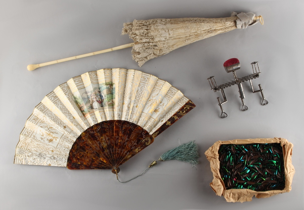 Lot 29 - Property of a lady - a Victorian ivory & lace folding parasol; together with a tortoiseshell &