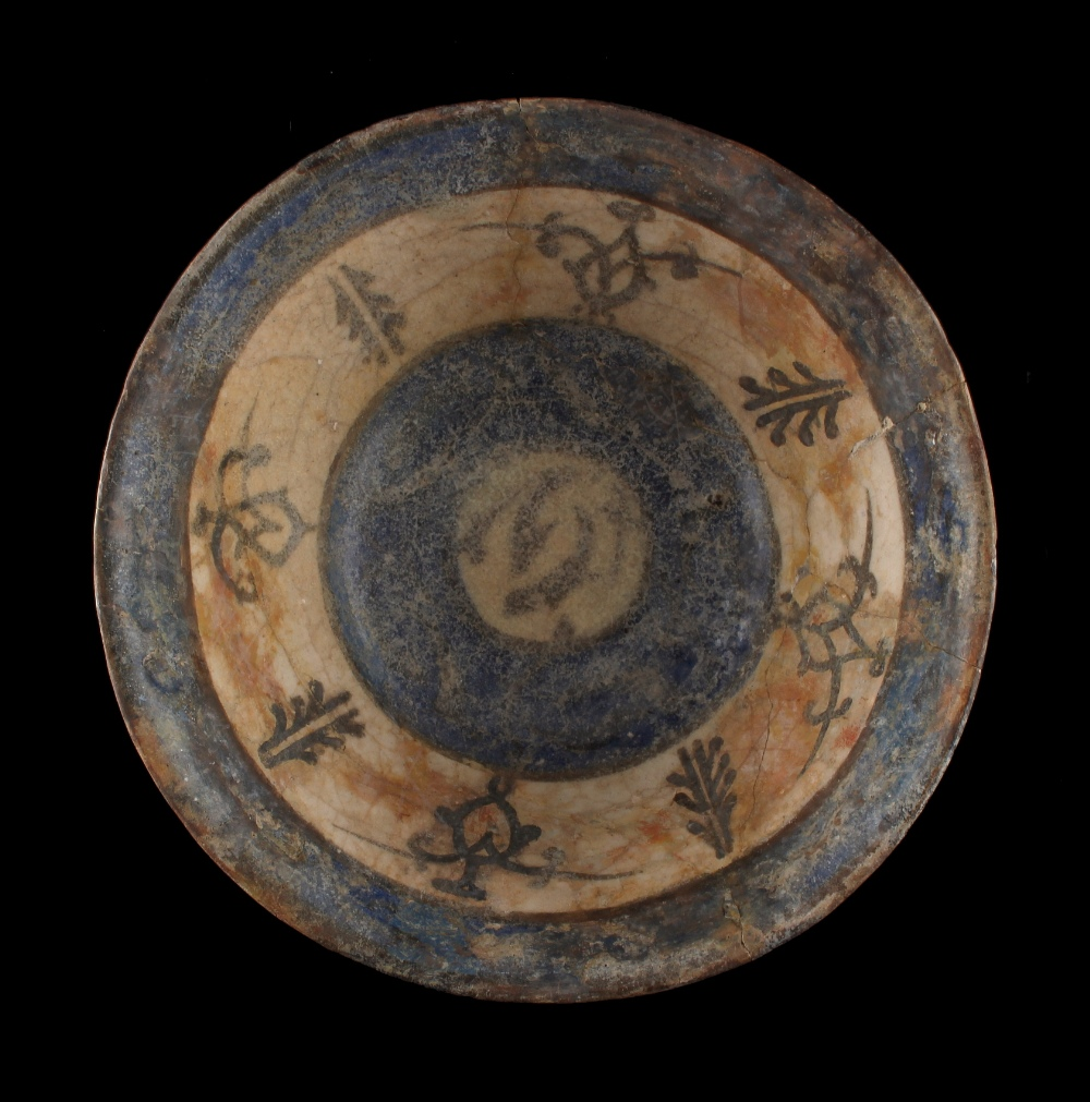 Lot 20 - Property of a gentleman - a Persian faience bowl, 19th century or earlier, restored, 7.25ins. (18.