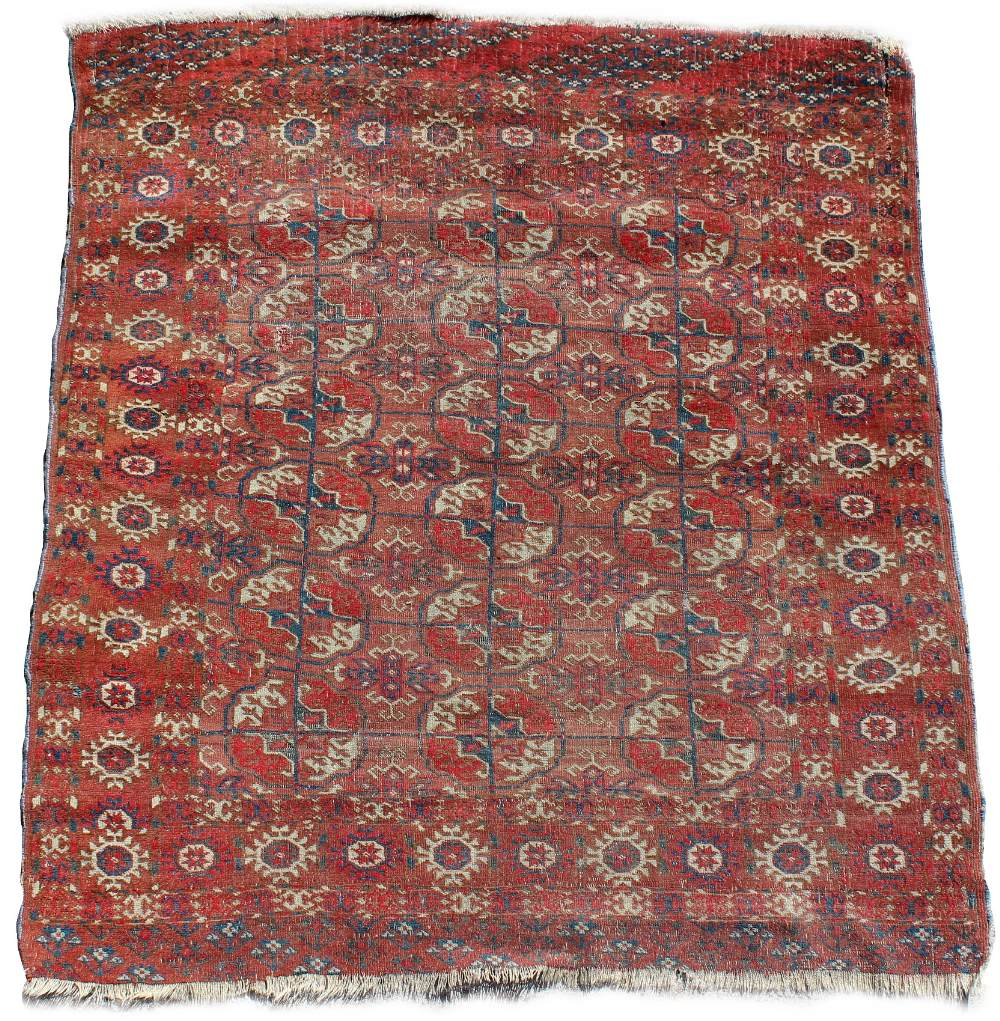 Lot 55 - Property of a deceased estate - an early 20th century Turkoman rug, 49 by 44ins. (125 by 112cms.).
