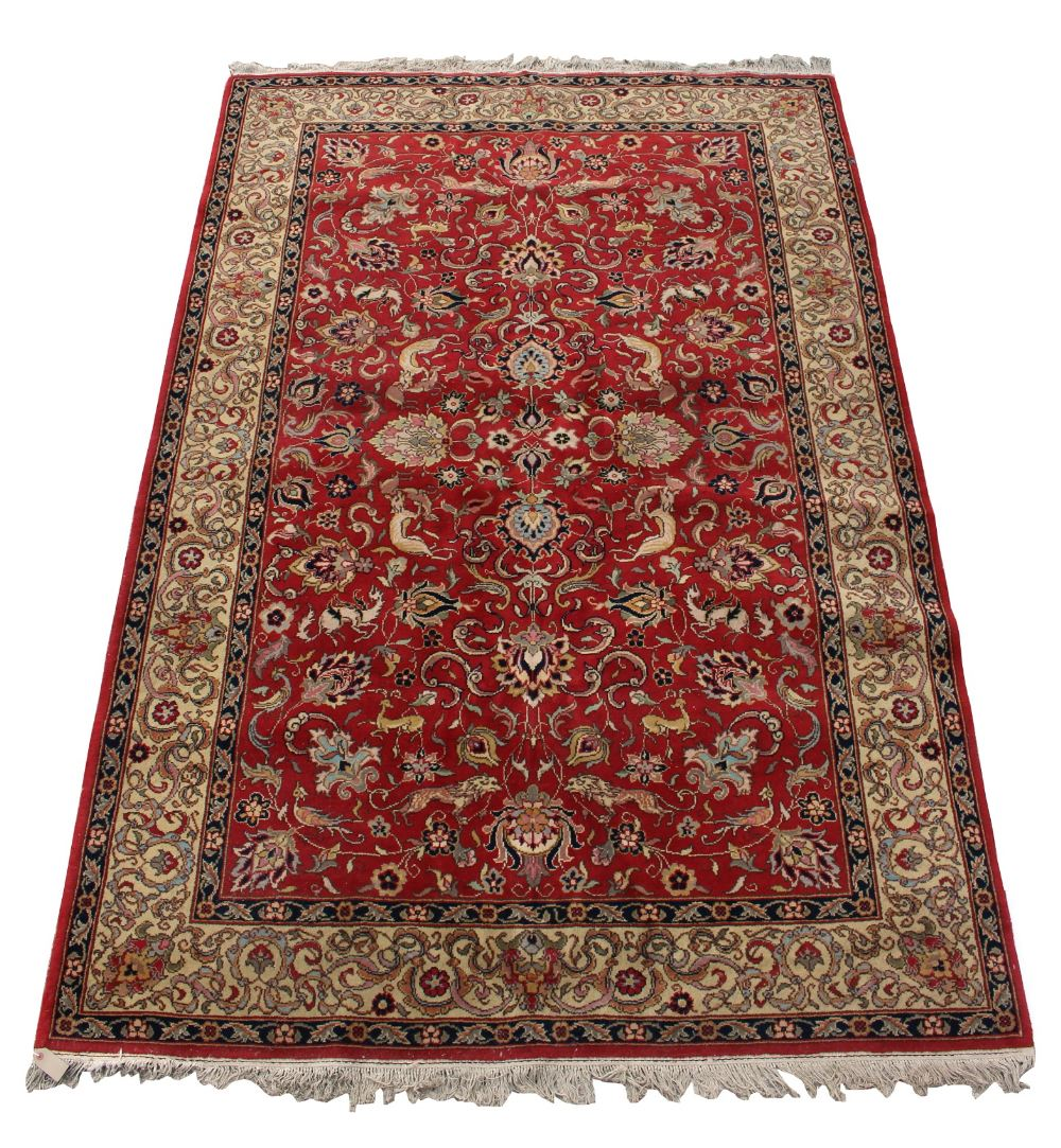 Lot 54 - Property of a gentleman - a Tabriz style woollen hand knotted carpet, decorated with various animals