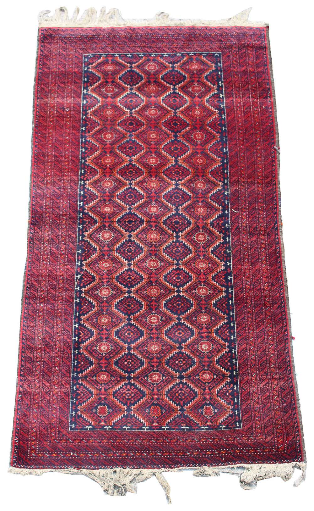 Lot 53 - Property of a deceased estate - an early / mid 20th century Turkoman rug, 71 by 38ins. (181 by