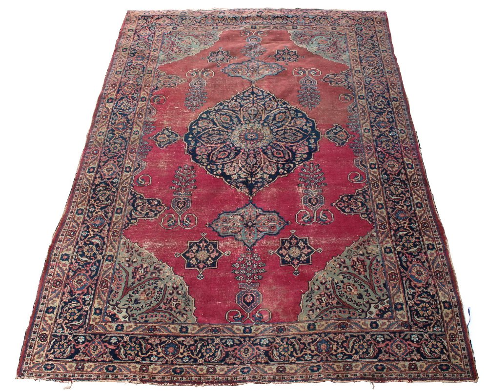 Lot 58 - Property of a gentleman - an antique Kirman Laver carpet, worn, 132 by 92ins. (336 by 234cms.).