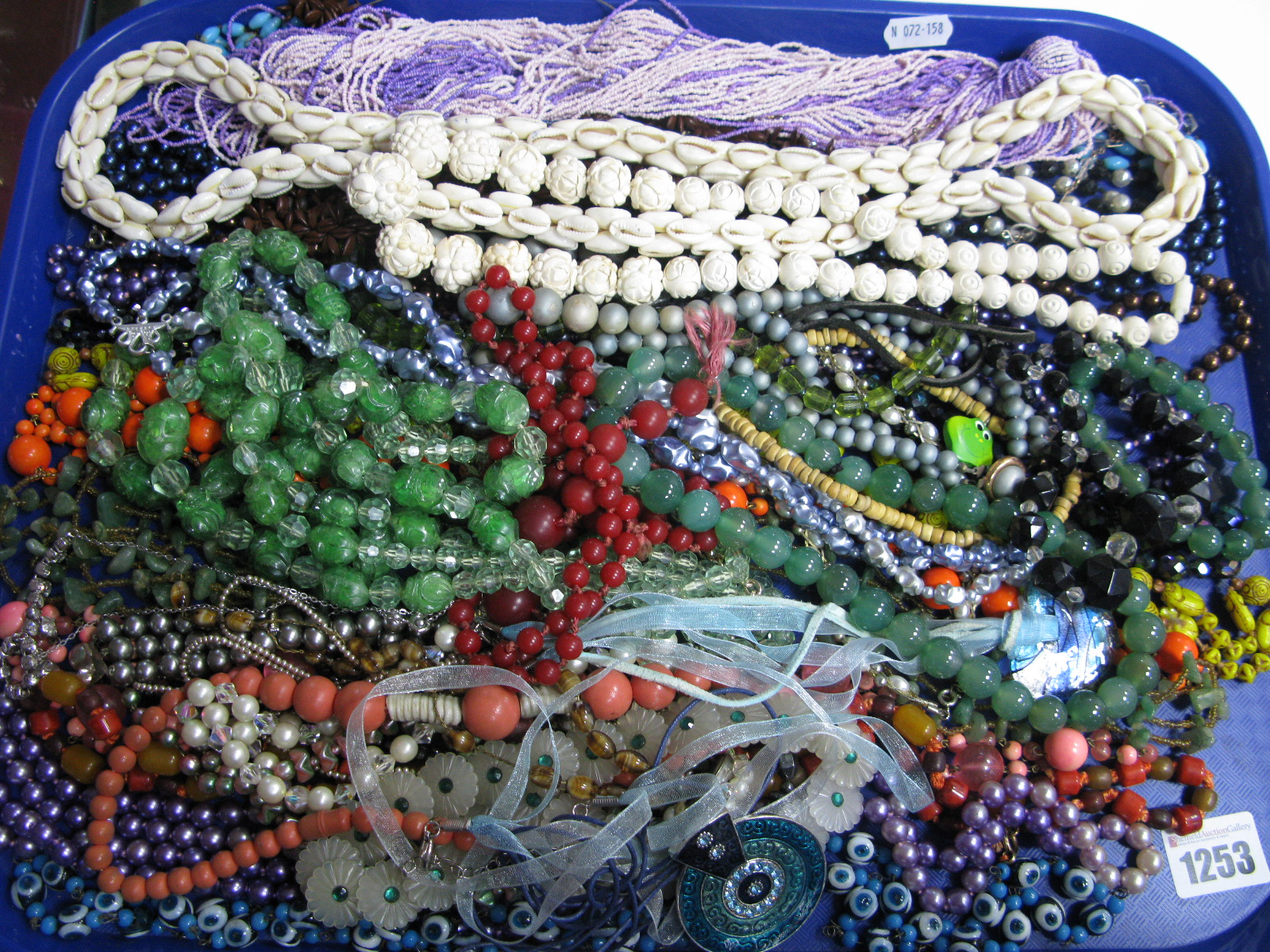 Lot 1253 - A Large Selection of Costume Bead Necklaces:- One Tray