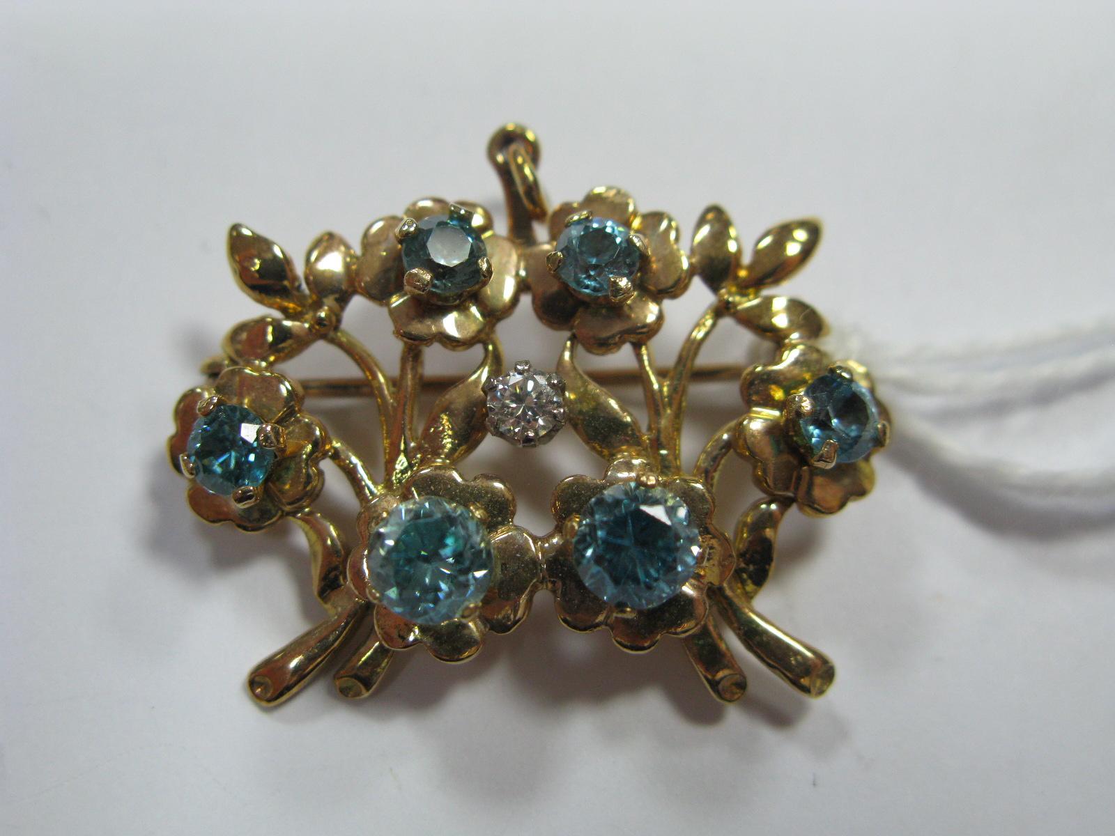 Lot 1363 - A Modern Floral Design Blue Zircon Set Brooch/Pendant.