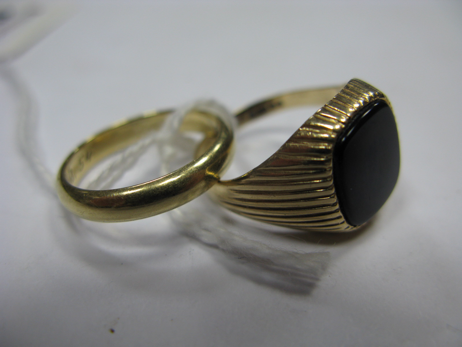 Lot 1344 - A Gent's 9ct Gold Ring, with inset cushion shape panel, between reeded shoulders; together with a