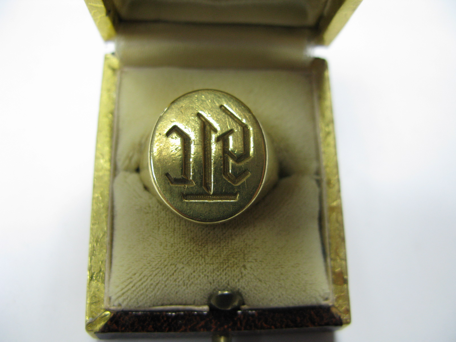 """Lot 1369 - A Gent's Signet Ring, initialled, indistinctly stamped """"750"""" (shank cut)."""