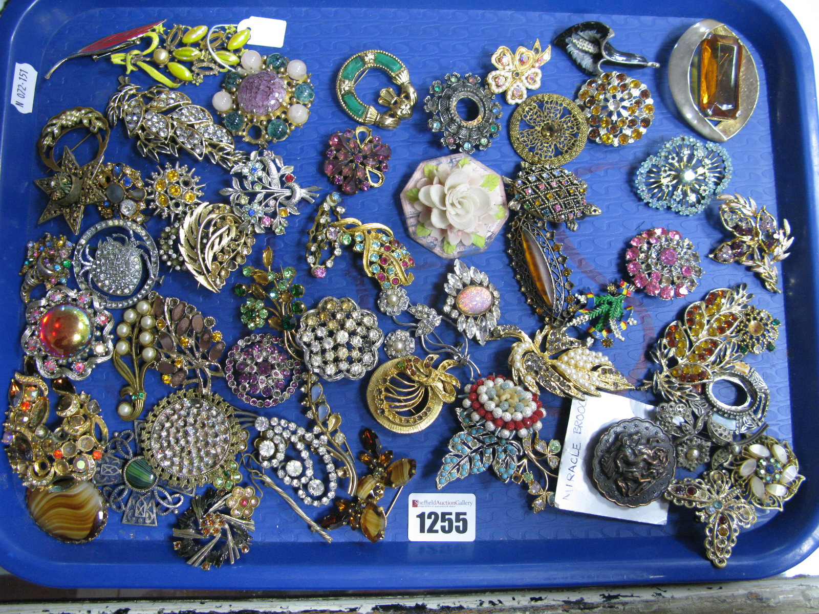Lot 1255 - A Mixed Lot of Assorted Costume Brooches, including Miracle, Claddagh and other floral brooches,