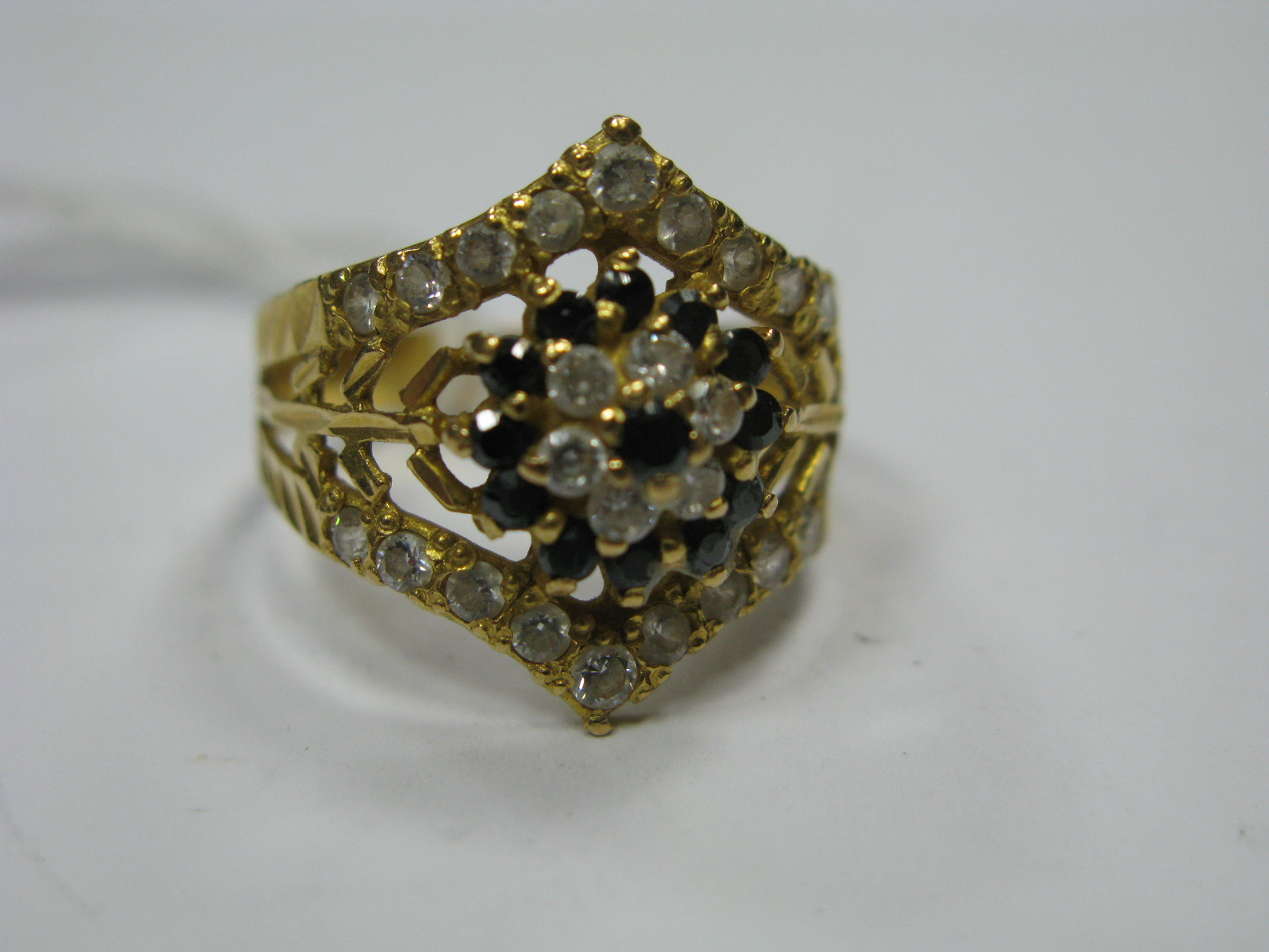 "Lot 1357 - A Stone Set Ring, with cluster style centre and wishbone frame, stamped ""22K""."