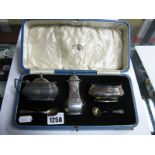Lot 1258 - Silver Hallmarked Three Piece Condiment Set, with blue glass liners, two spoons (cased).