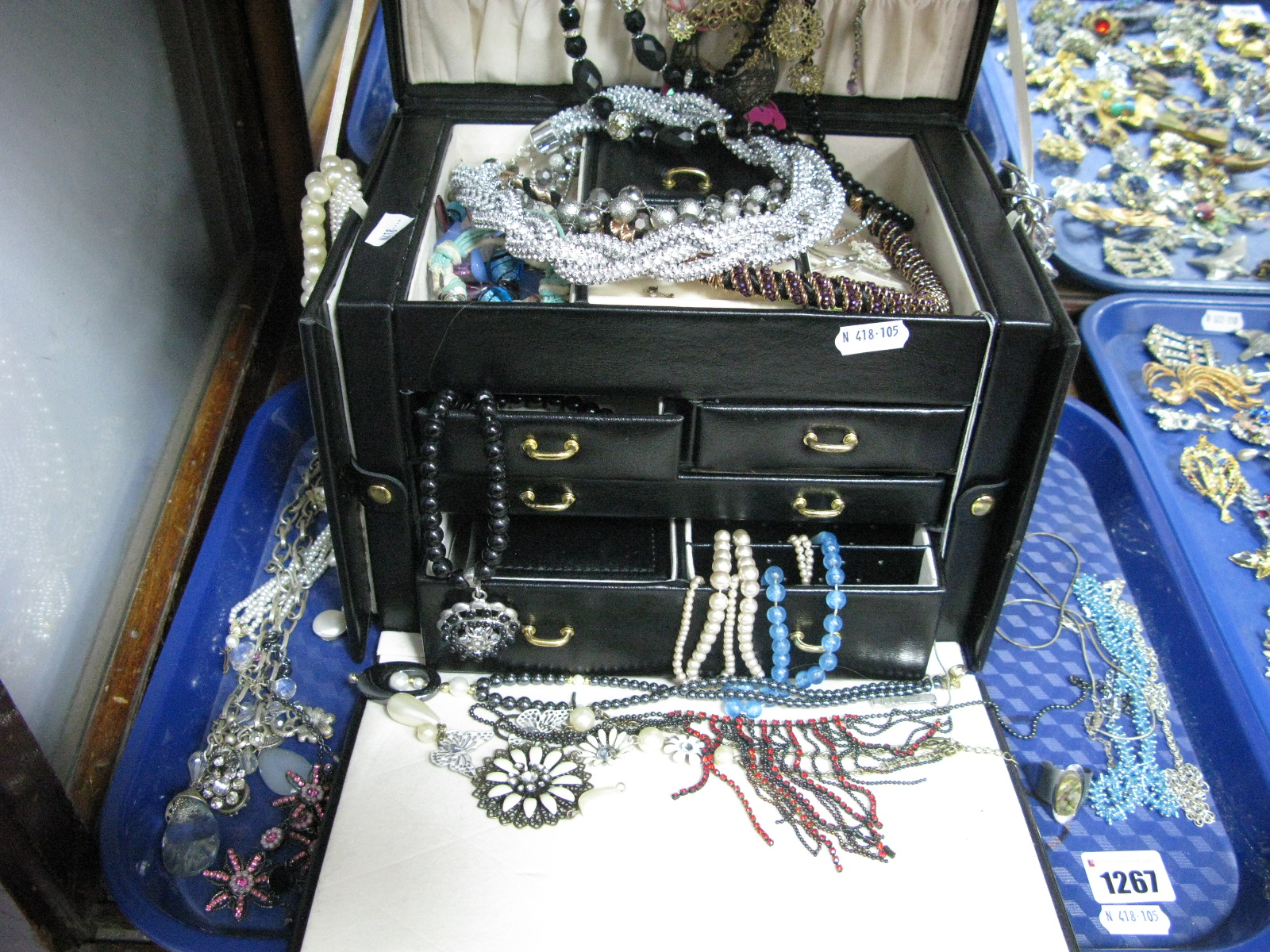 Lot 1267 - A Large Black Jewellery Box, together with assorted costume jewellery, imitation pearls, etc:- One