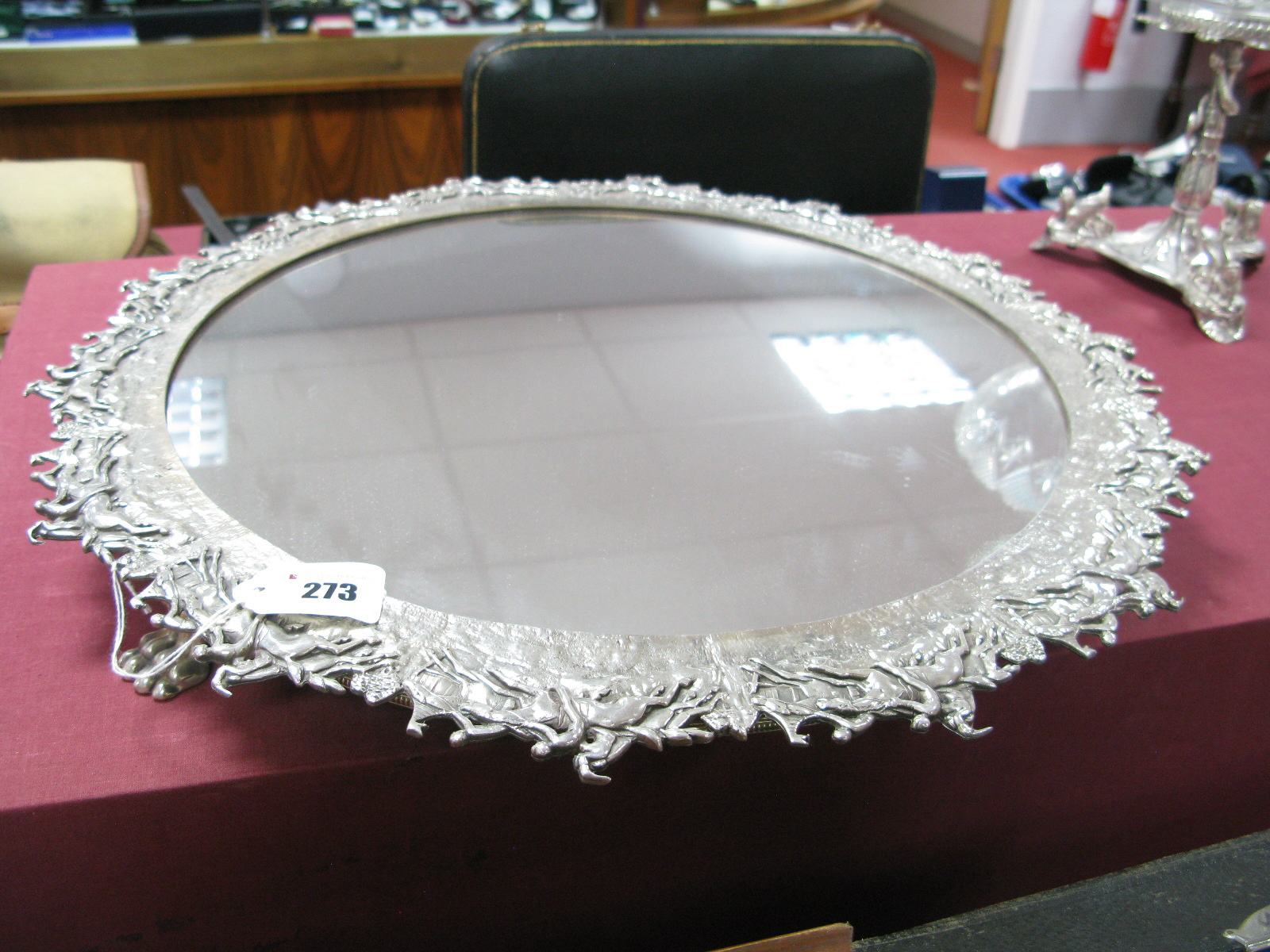Lot 273 - A Silver Plated Mirror Plateau, of circular form, the intricate border detailed in relief with