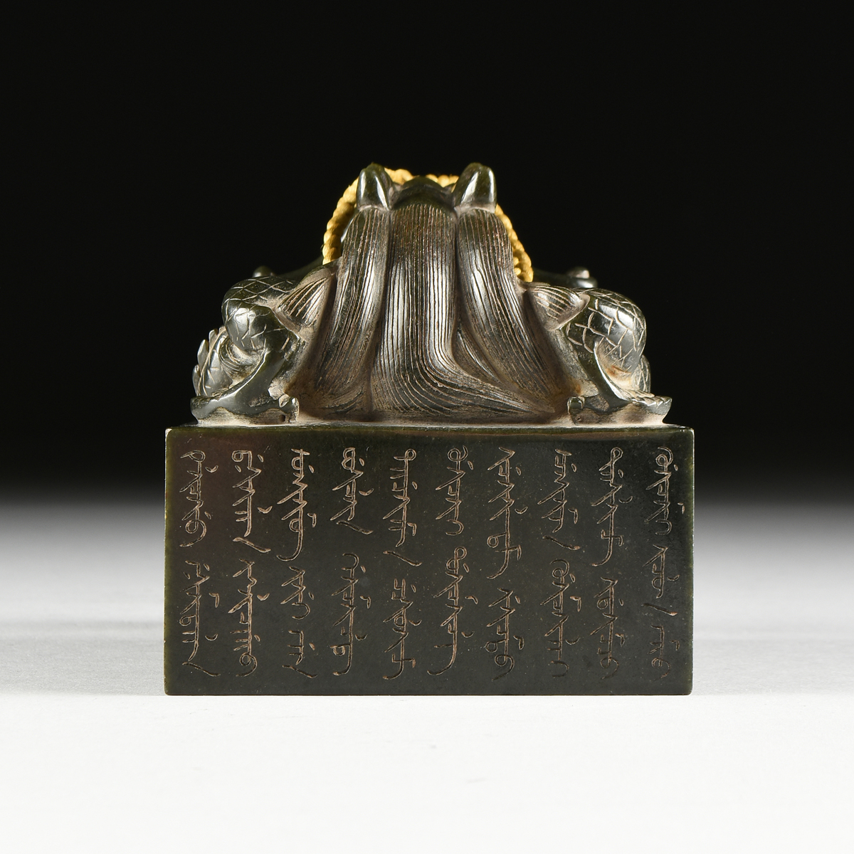 Lot 24 - A QING DYNASTY STYLE DARK GREEN HARDSTONE COURT SEAL FOR DELIVERING INSTRUCTIONS IN A ZITAN BOX,