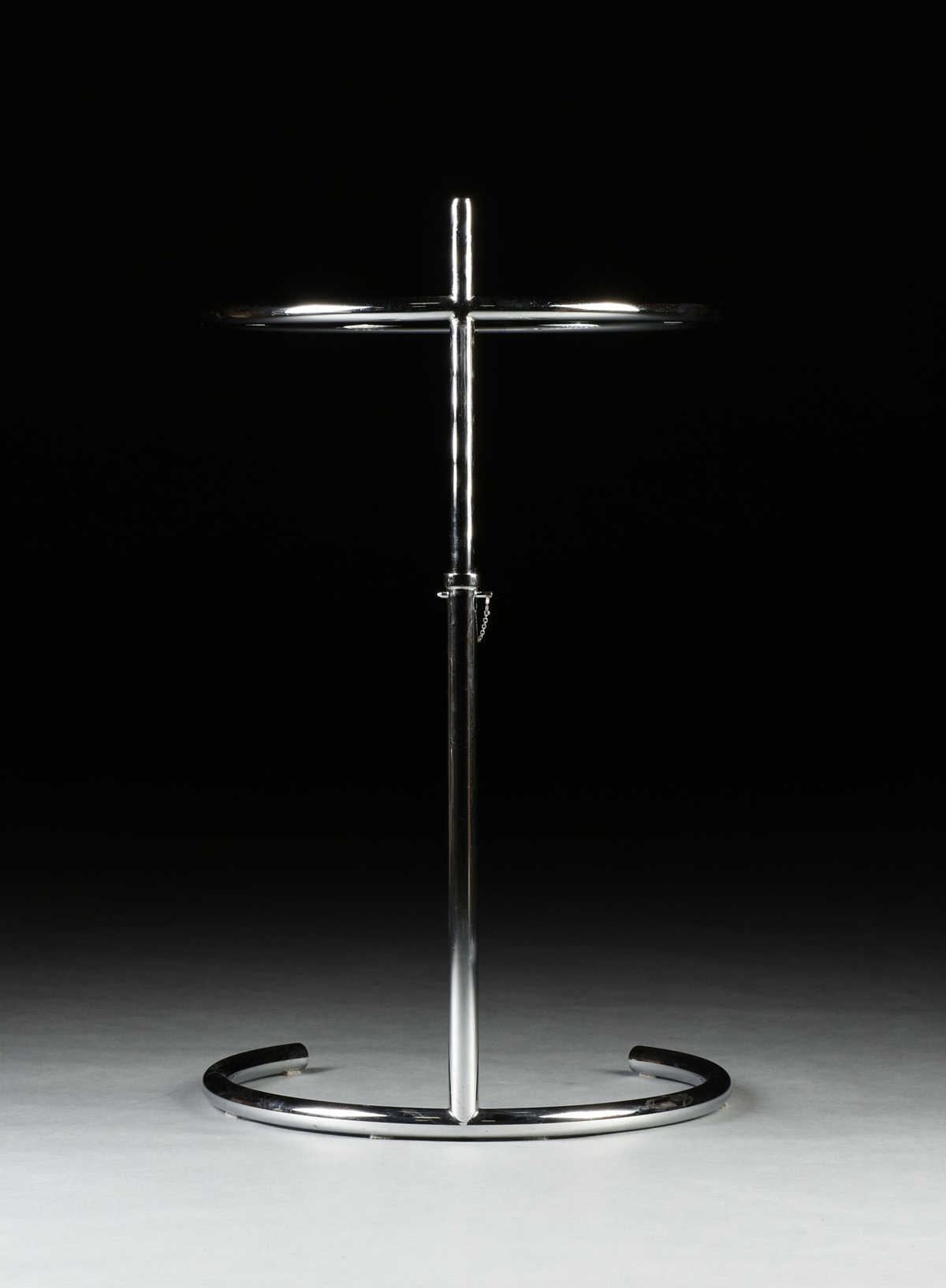 Lot 25 - AN EILEEN GRAY ADJUSTABLE GLASS AND CHROME CIRCULAR SIDE TABLE, MODEL NUMBER 1027, 1960s, the