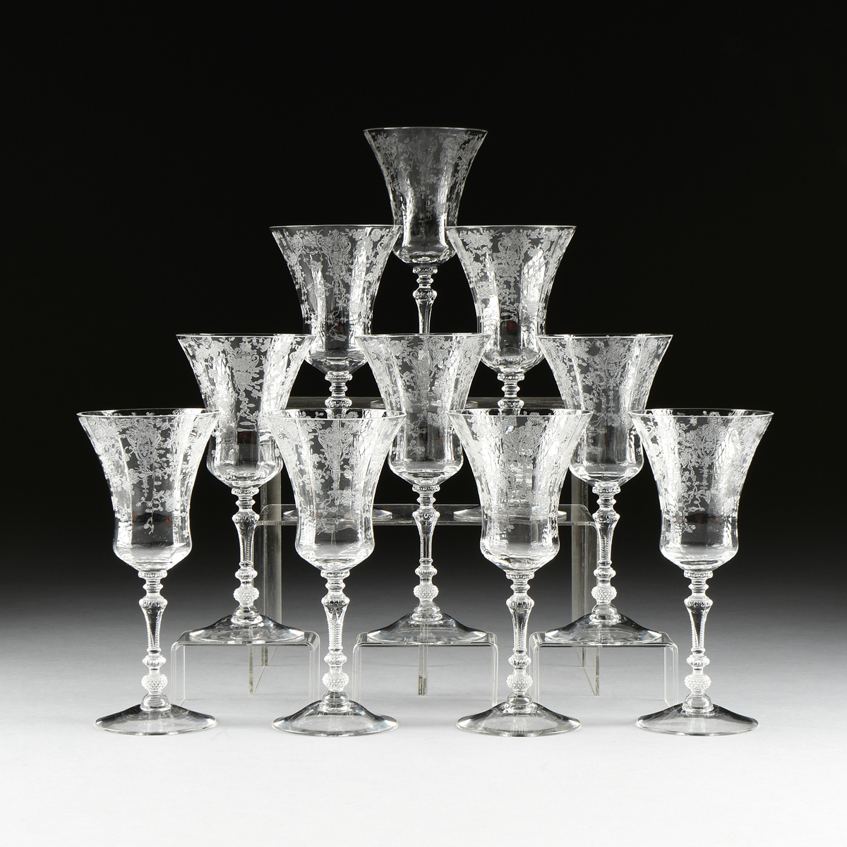 Lot 13 - A SET OF ELEVEN ACID ETCHED LOBED WATER GOBLET STEMWARE, AMERICAN, FIRST HALF 20TH CENTURY, the