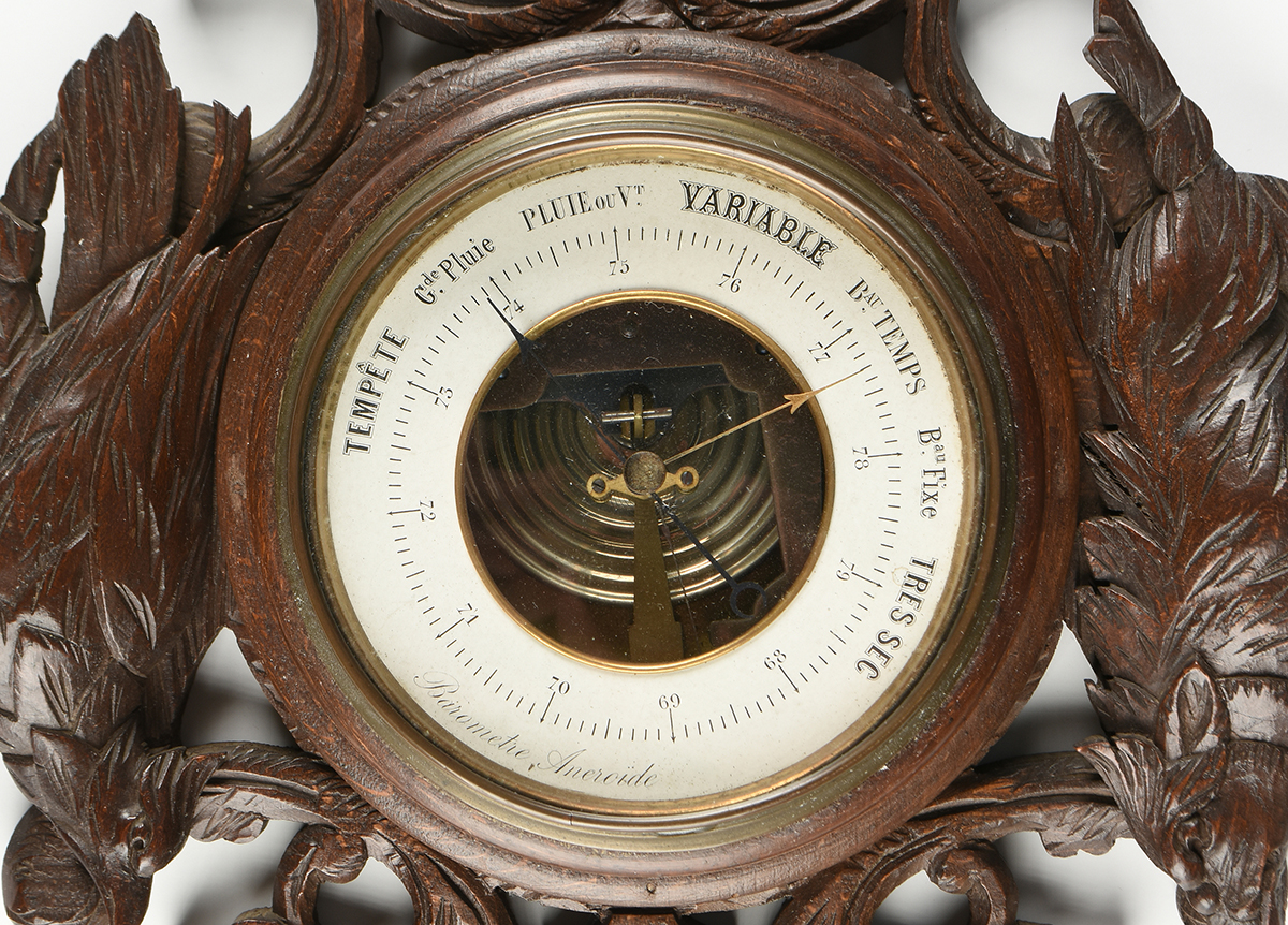 Lot 14 - A FRENCH BLACK FOREST STYLE CARVED WOOD BAROMETER ANEROID, EARLY 20TH CENTURY, with a carved