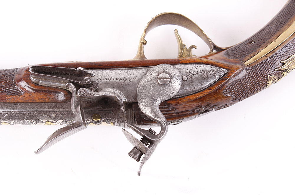 Lot 627 - (S58) 18 bore Italian flintlock holster pistol, 14 ins barrel decorated with embossed swags, stand