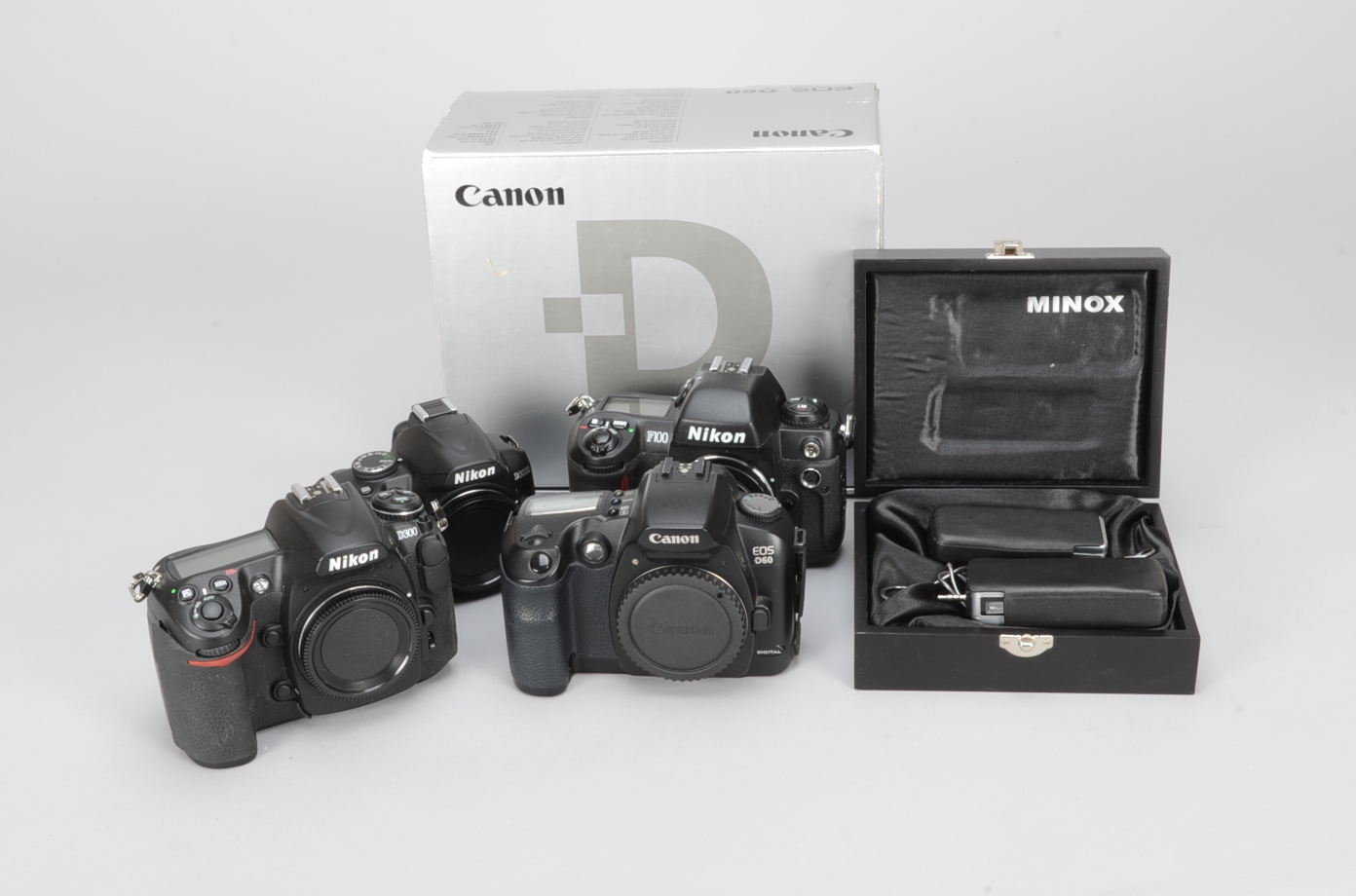 Lot 8 - A Group of Nikon and Canon Bodies, comprising a Canon D60 body, with battery, battery grip BG-ED3,