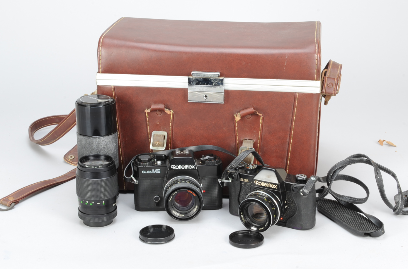 Lot 39 - Rolleiflex SL35 SLR Cameras and Lenses, black, shutter working, meter untested, a Rollei-HFT