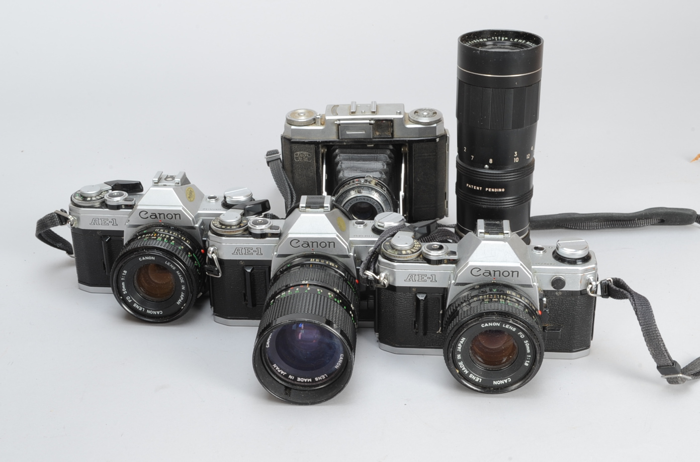 Lot 33 - Three Canon AE-1 SLR Cameras, serial no 3108368, shutter working, with an FD 35-70mm f/4 lens, no