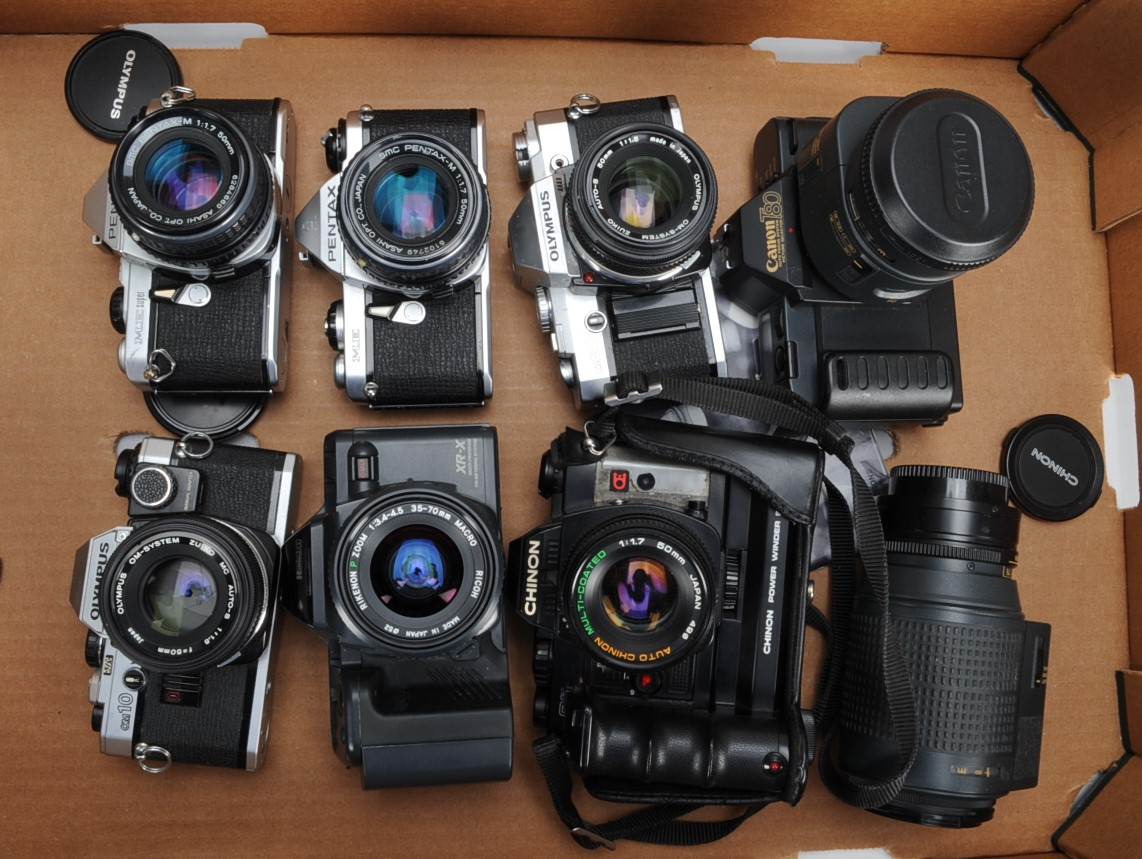 Lot 6 - A Group of 35mm SLR Cameras, A Canon T80 camera with Canon AC 35-70mm and 75-200mm autofocus lenses,