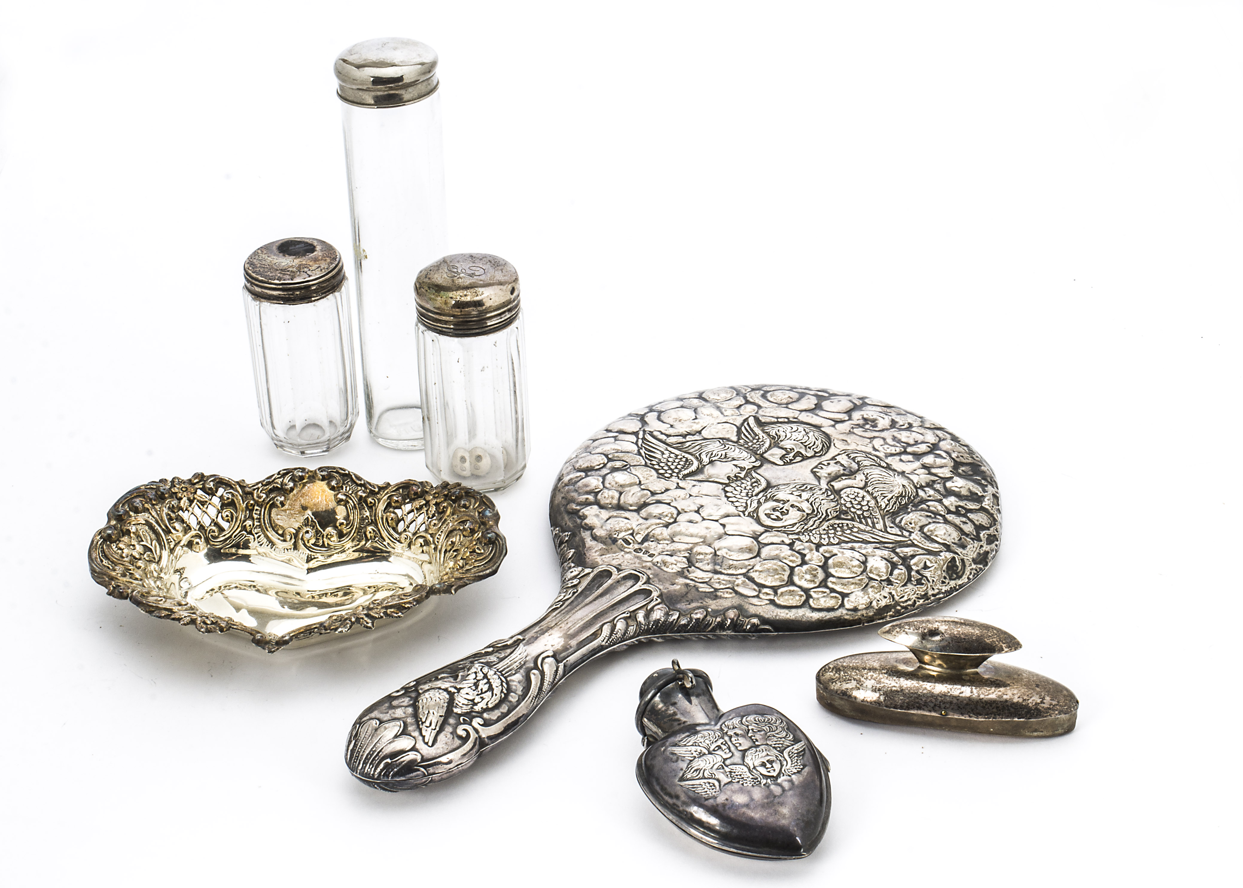Lot 41 - A Victorian silver hand mirror, together with a silver scent bottle holder lacking its bottle, a