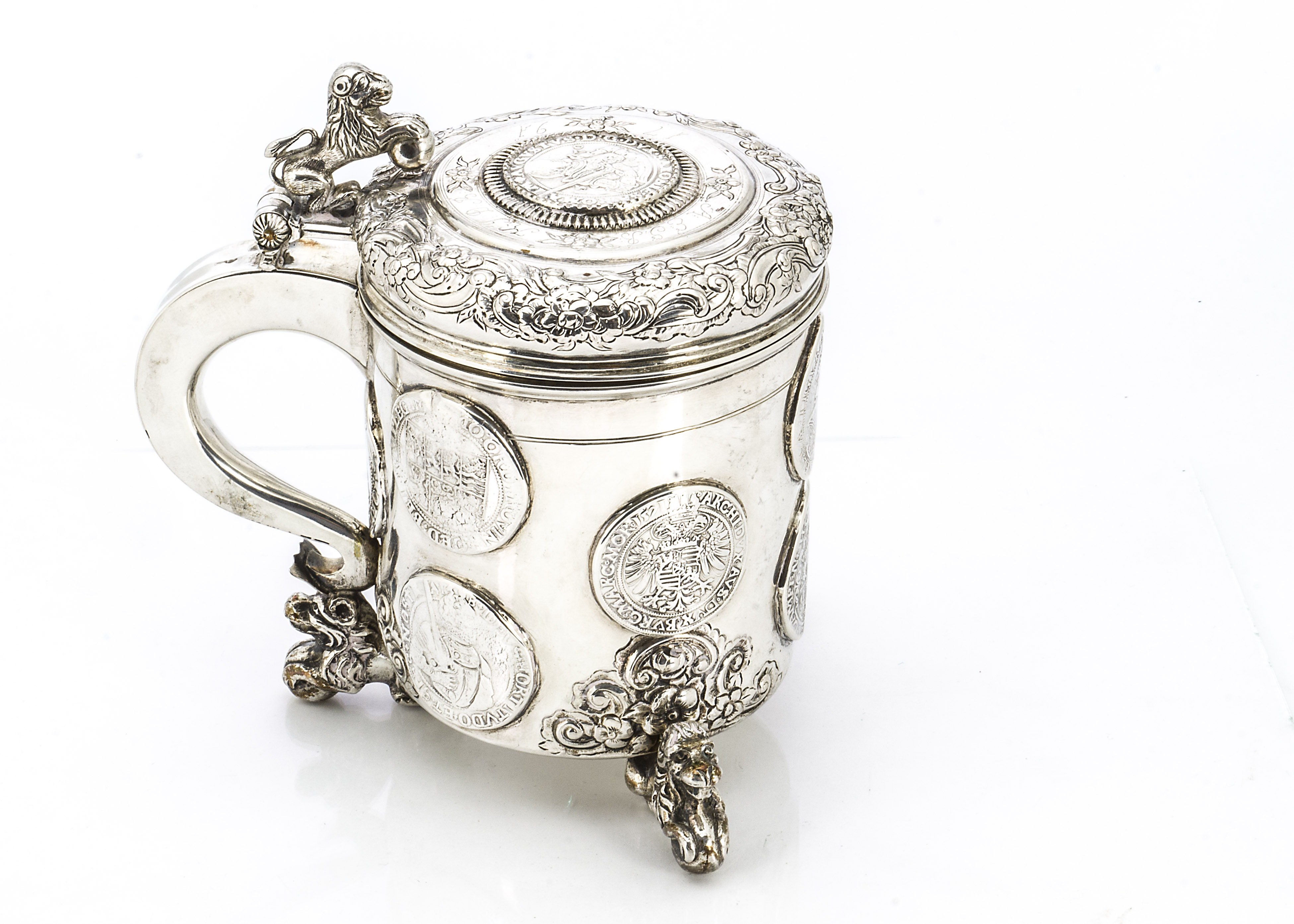 Lot 14 - An 18th century Norwegian silver tankard, three lion and ball supports with raised and engraved