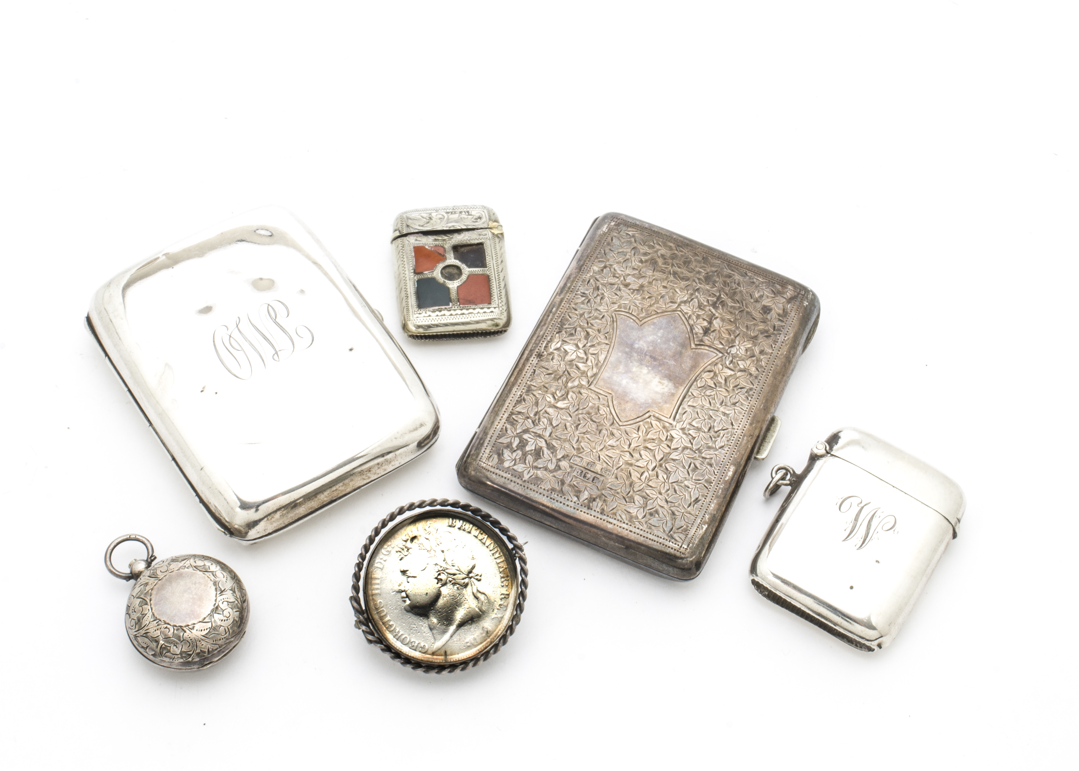 Lot 50 - Four Victorian and later collectable items of silver, including a purse, a cigarette case, a vesta