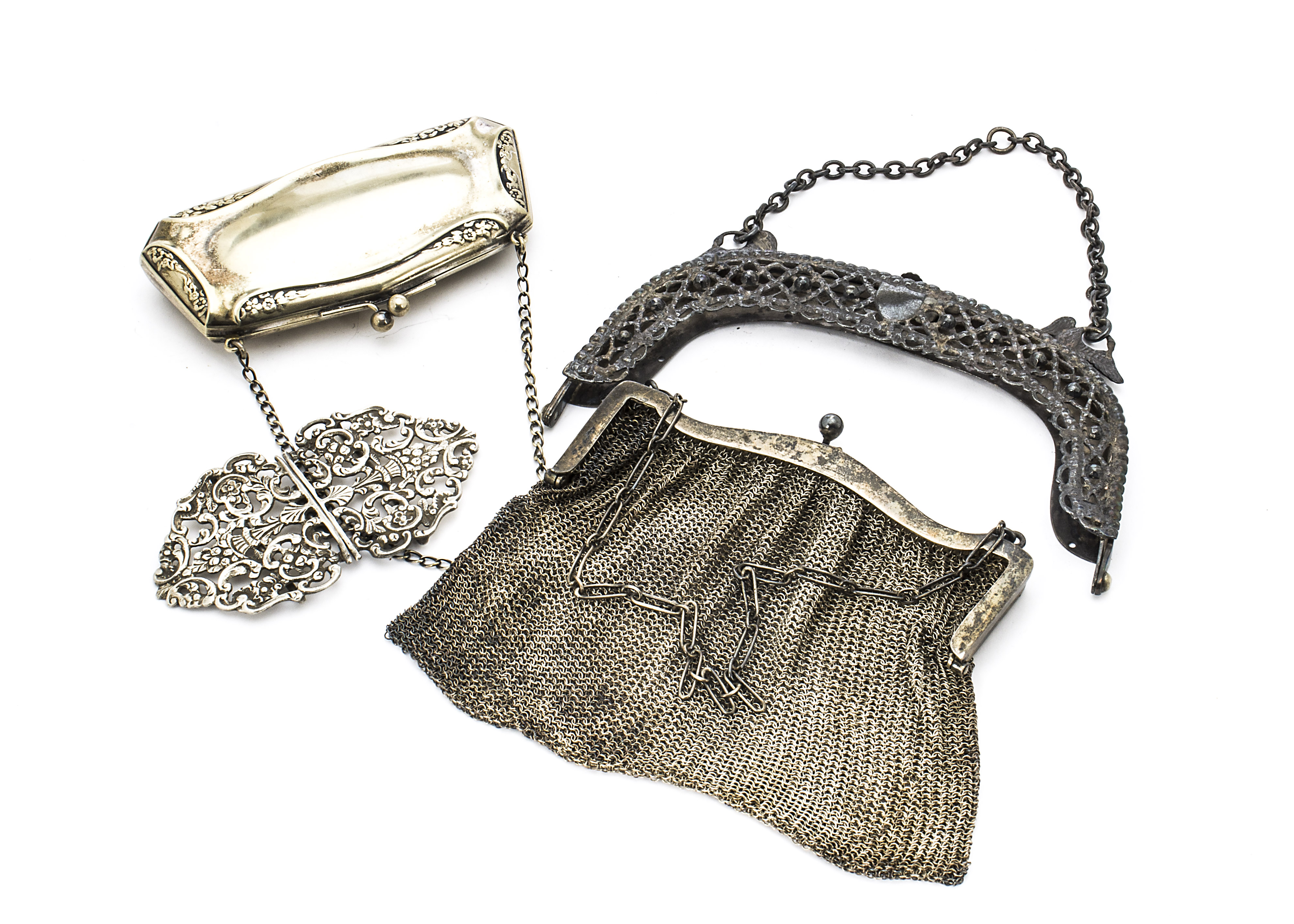 Lot 40 - A Victorian silver pierced nurse's belt buckle, together with a nice silver purse clasp, lacking its