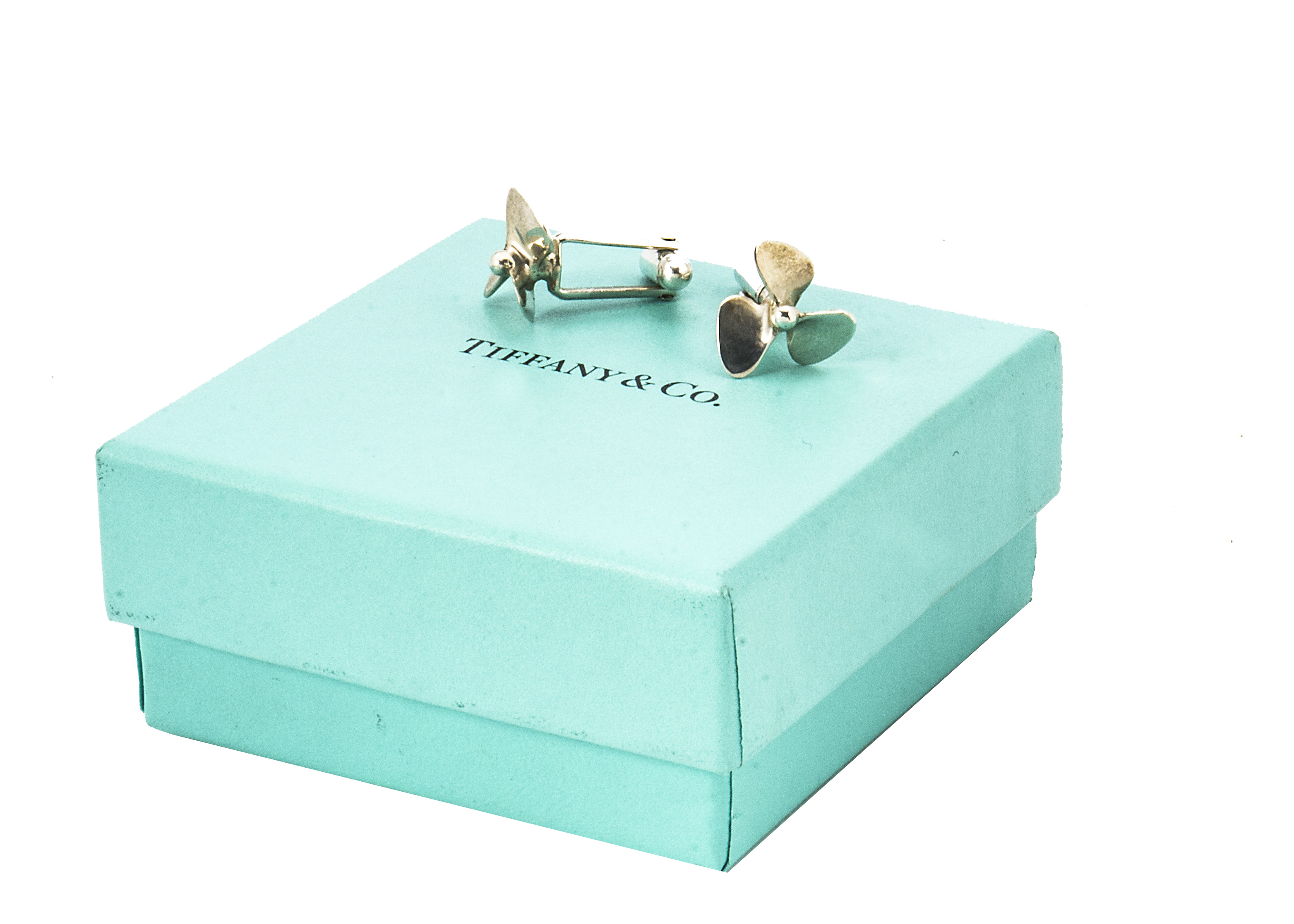 Lot 52 - A pair of modern silver cufflinks from Tiffany & Co, with propellers, in box and bag