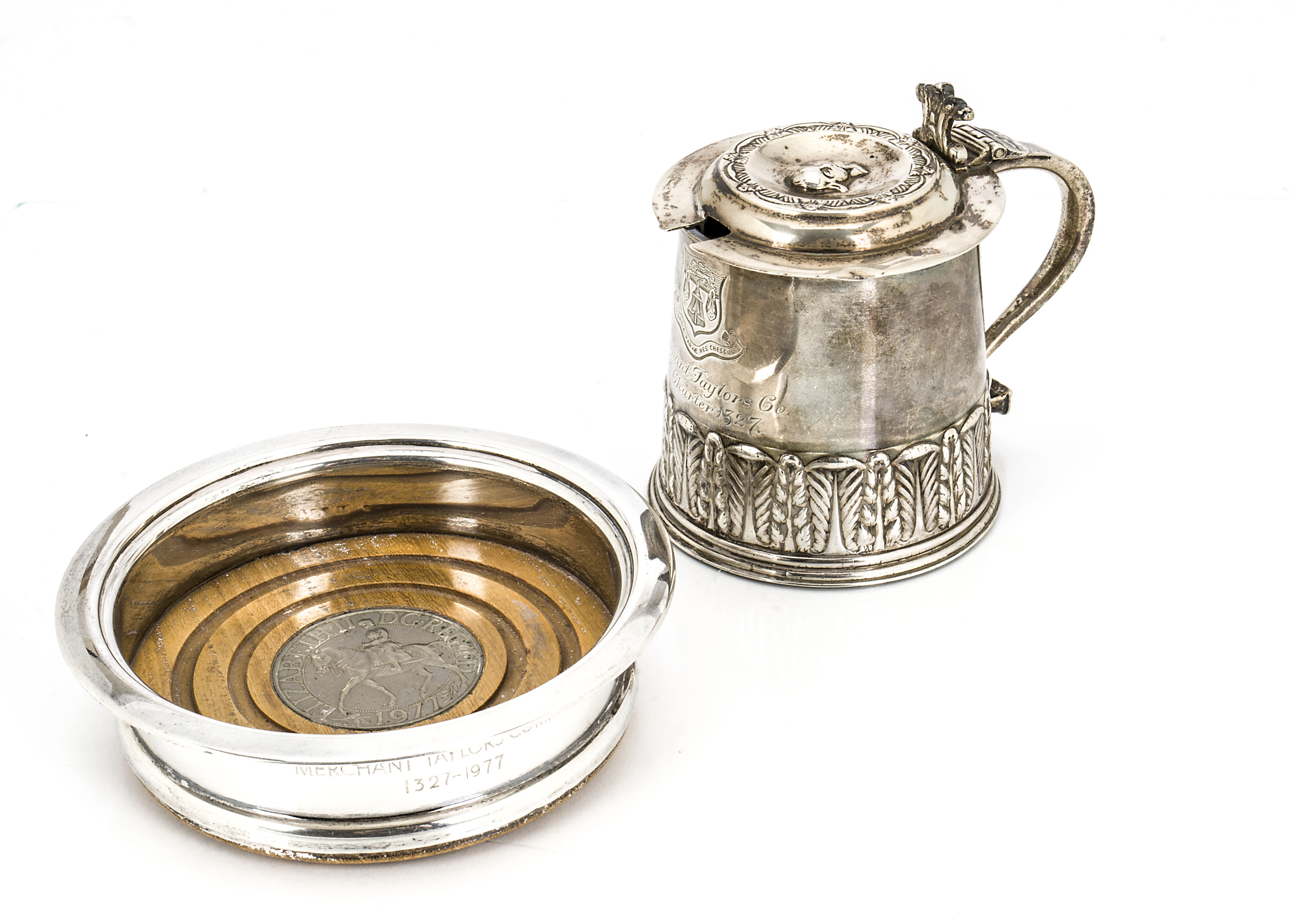 Lot 28 - A George V silver mustard tankard, engraved with the Merchant Taylors Company crest, with blue glass