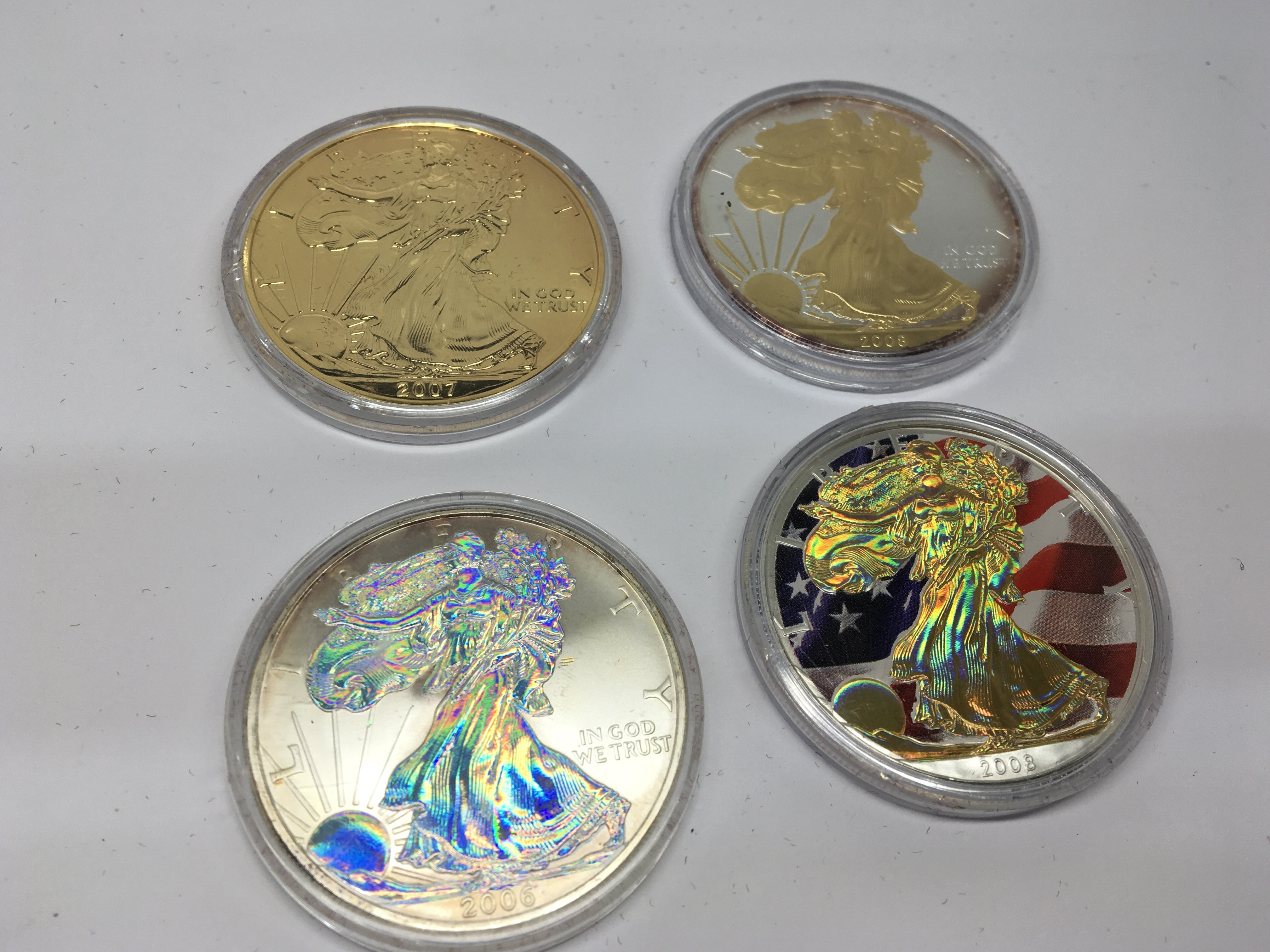 Lot 121 - A collection of four American Themed Silver Dollar