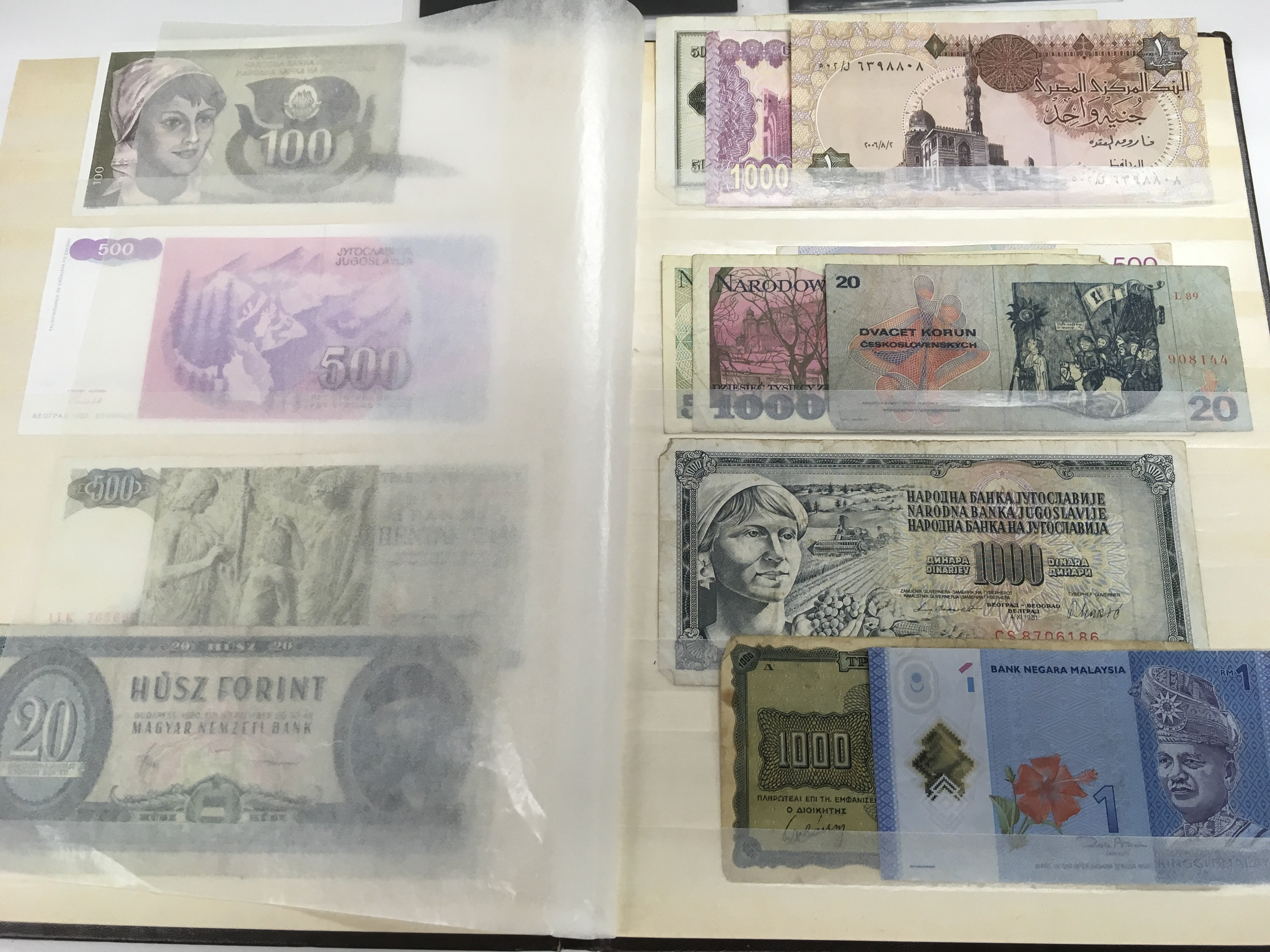 Lot 298 - An album of world banknotes including some consecu