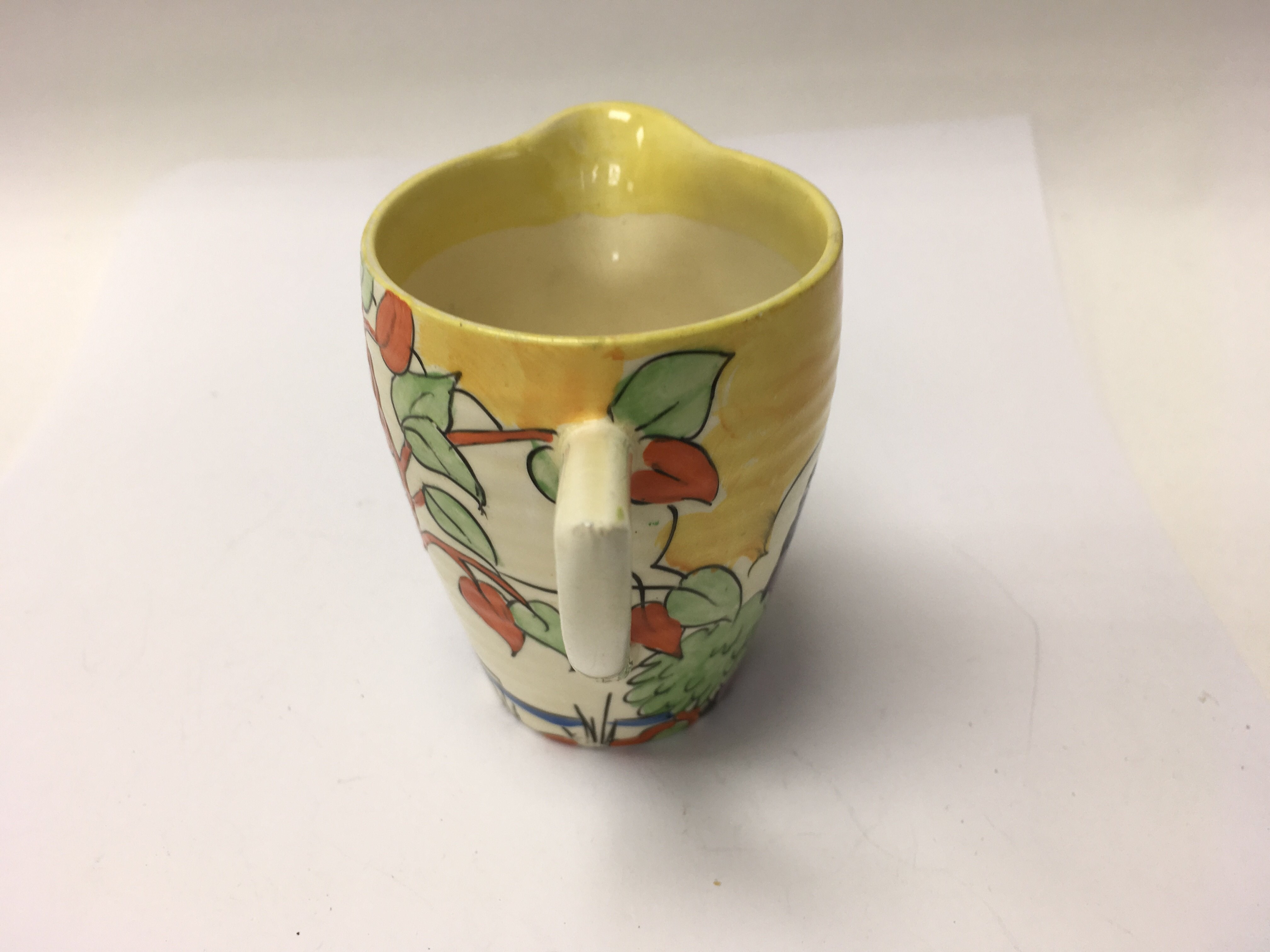 Lot 780 - A Clarice Cliff milk jug decorated in The japan pa