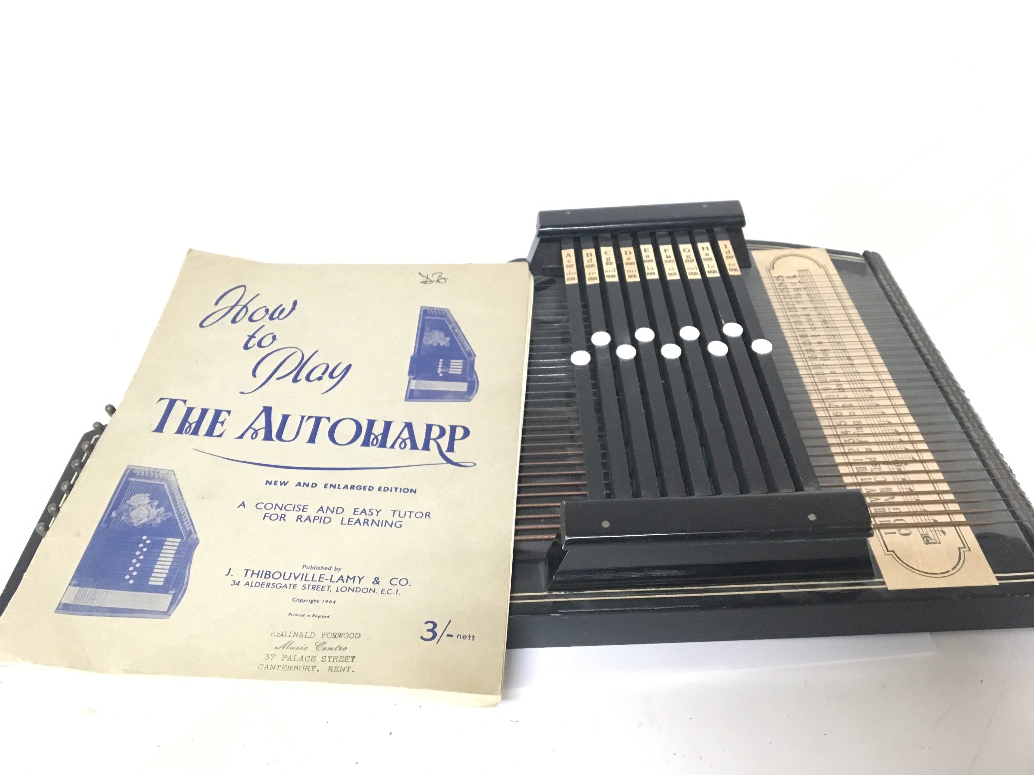Lot 1898 - A Vintage Autoharp with a book of instructions.