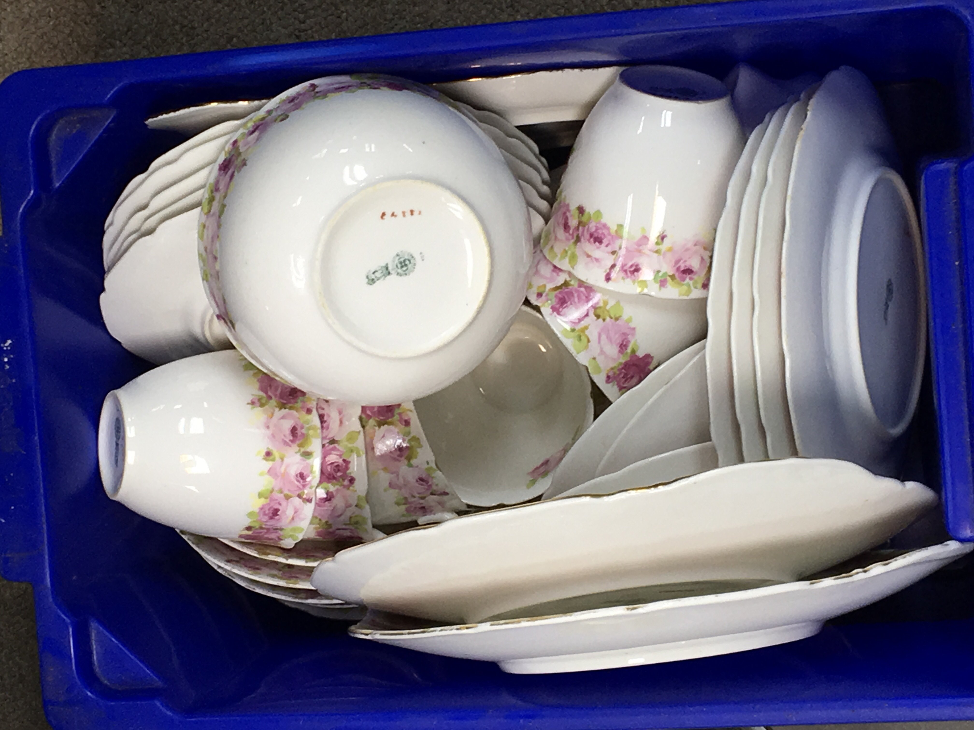 Lot 750 - A Royal Doulton tea set decorated with roses a pai