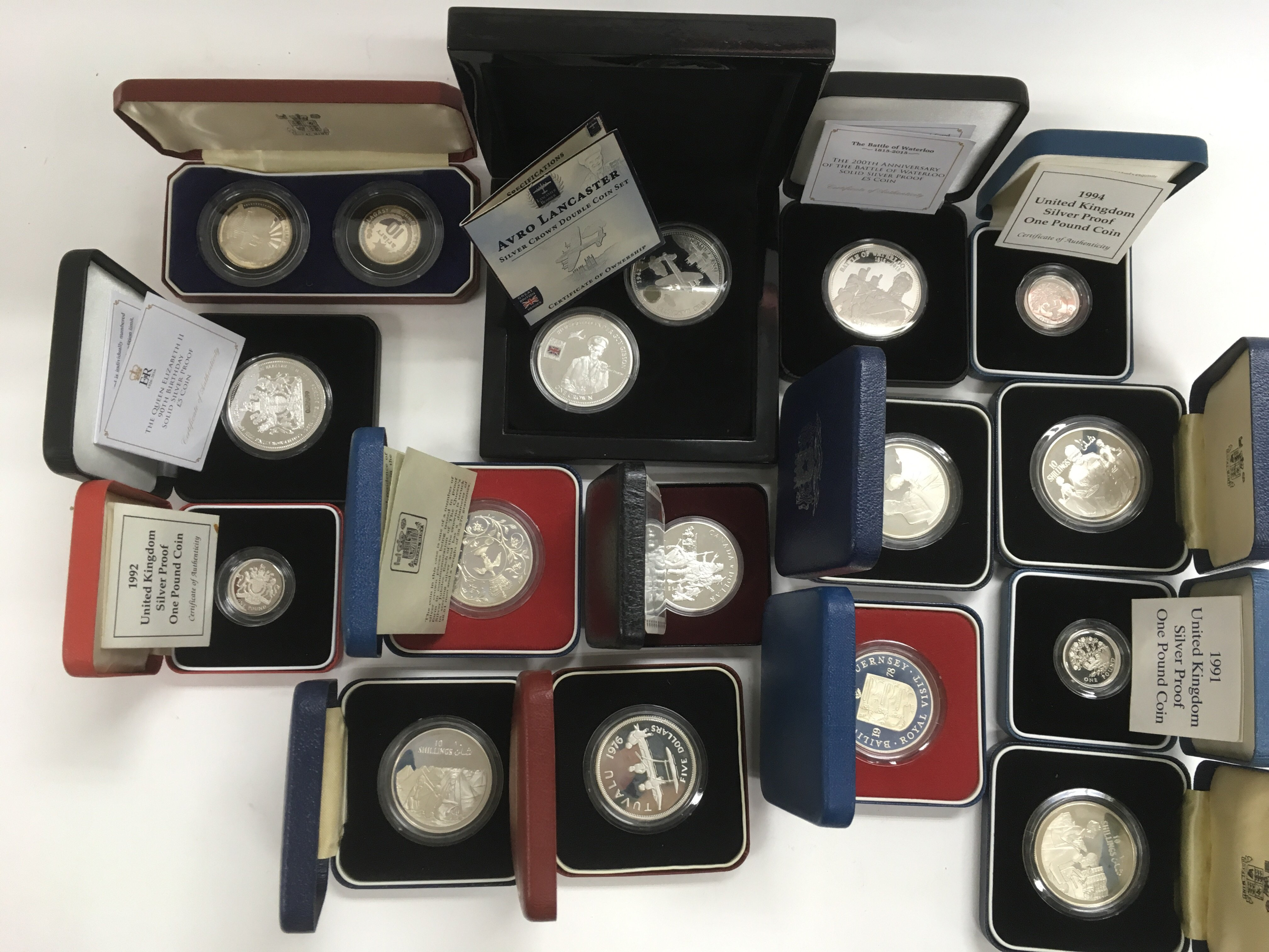 Lot 333 - Fifteen sets of cased commemorative silver proof c