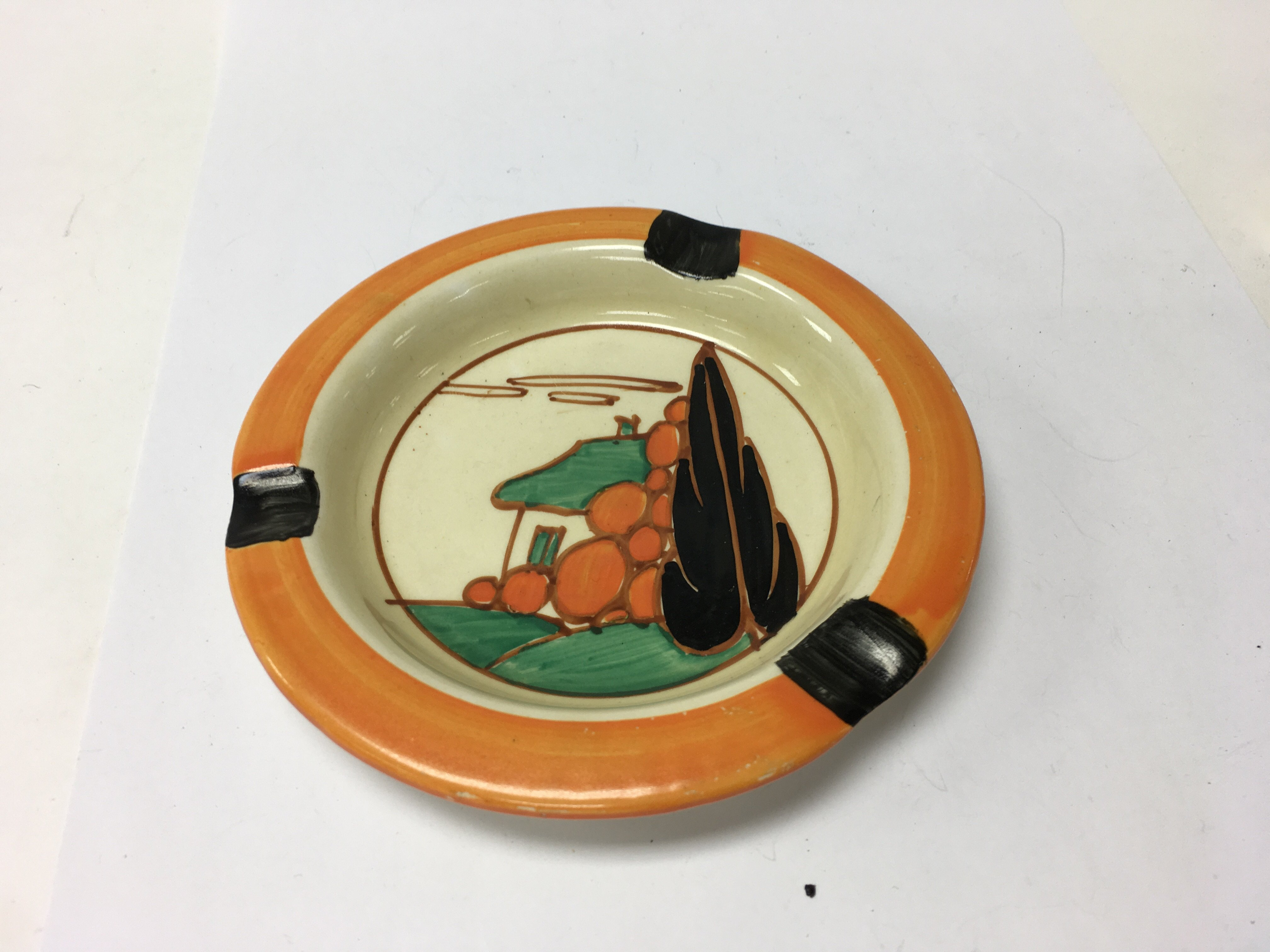 Lot 784 - A Clarice Cliff ash tray decorated with the house