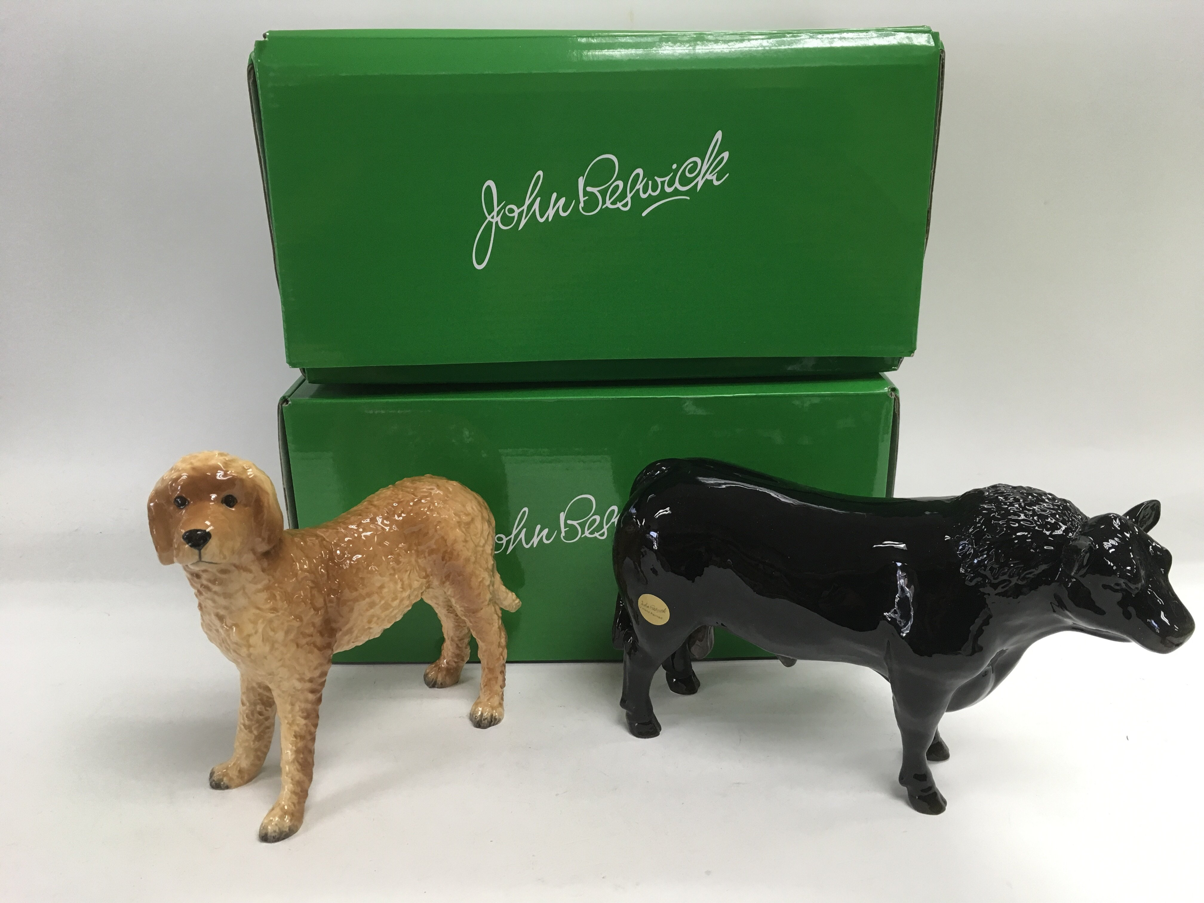 Lot 756 - Two boxed Beswick animal figures comprising a dog