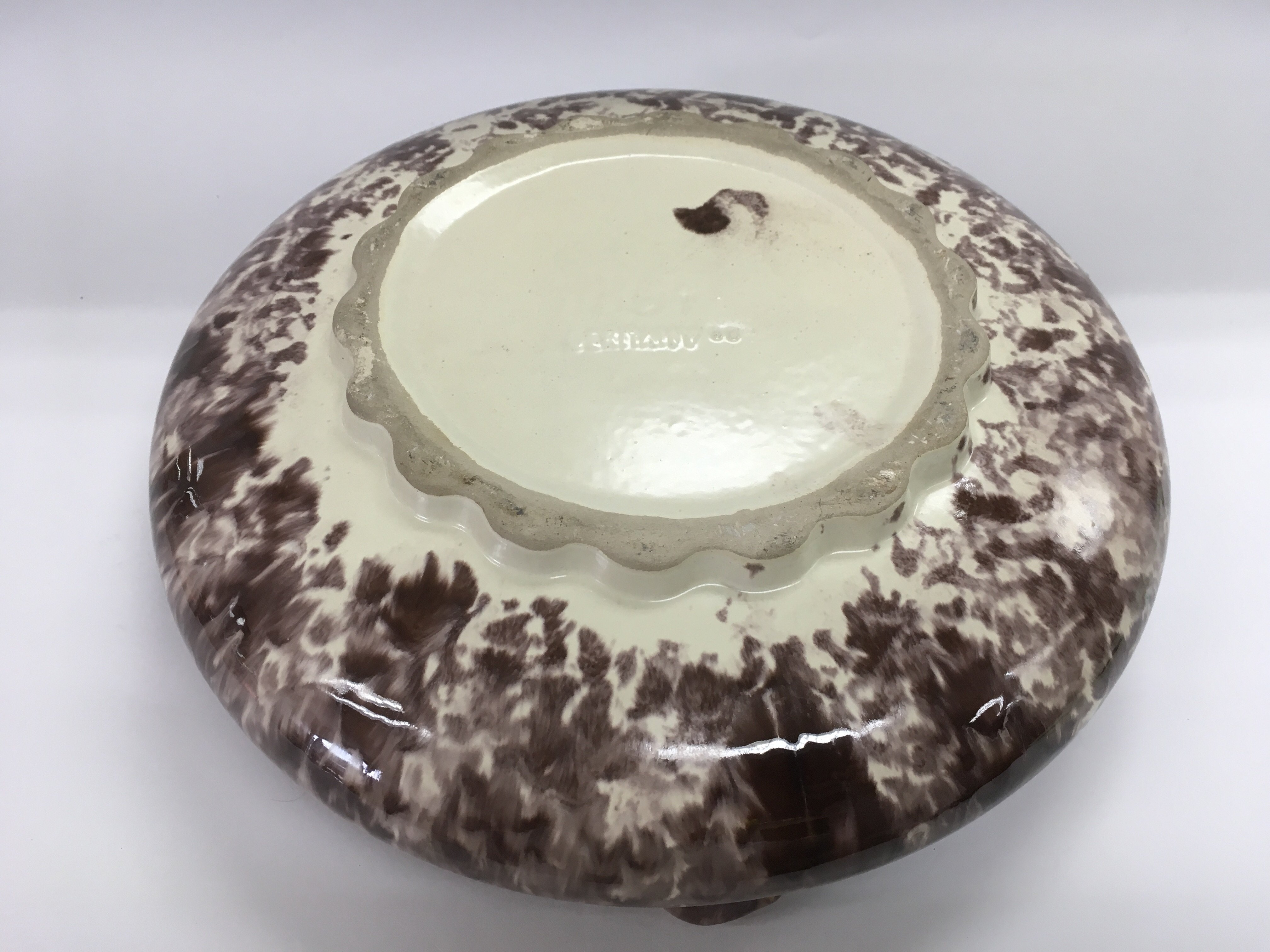 Lot 708 - A German art pottery charger, approx diameter 35cm