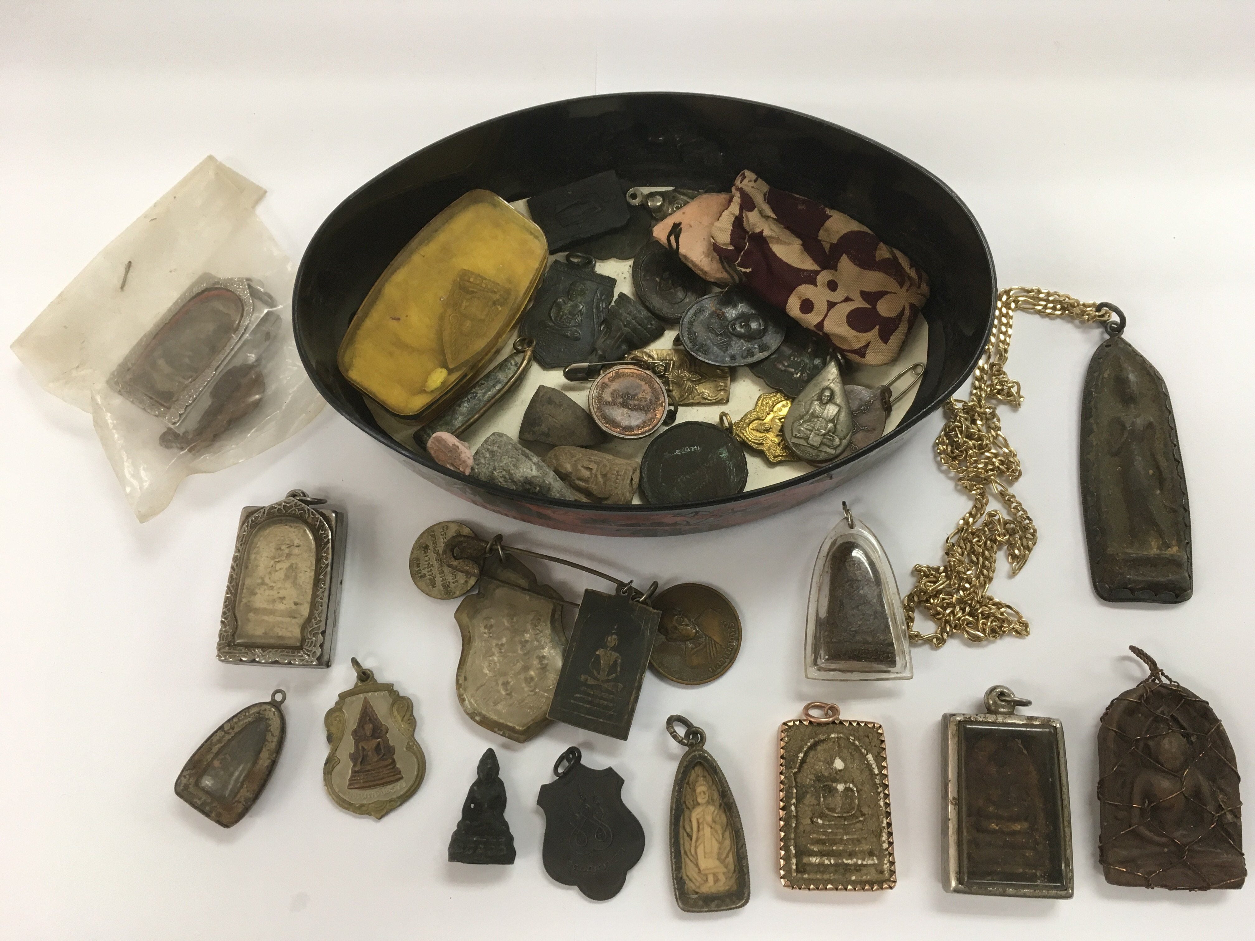 Lot 388 - A collection of old Buddha pendants and charms.