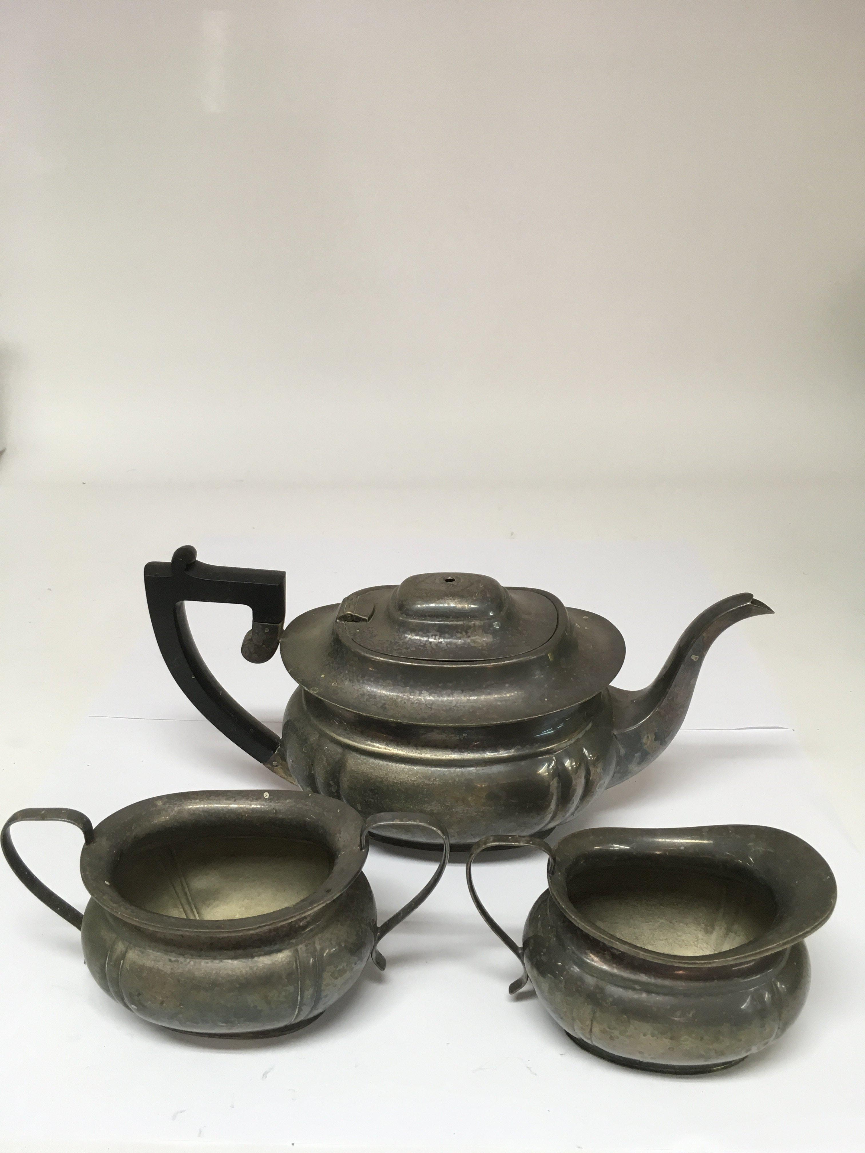 Lot 163 - A Garrard and Co. three piece silver plated teaset