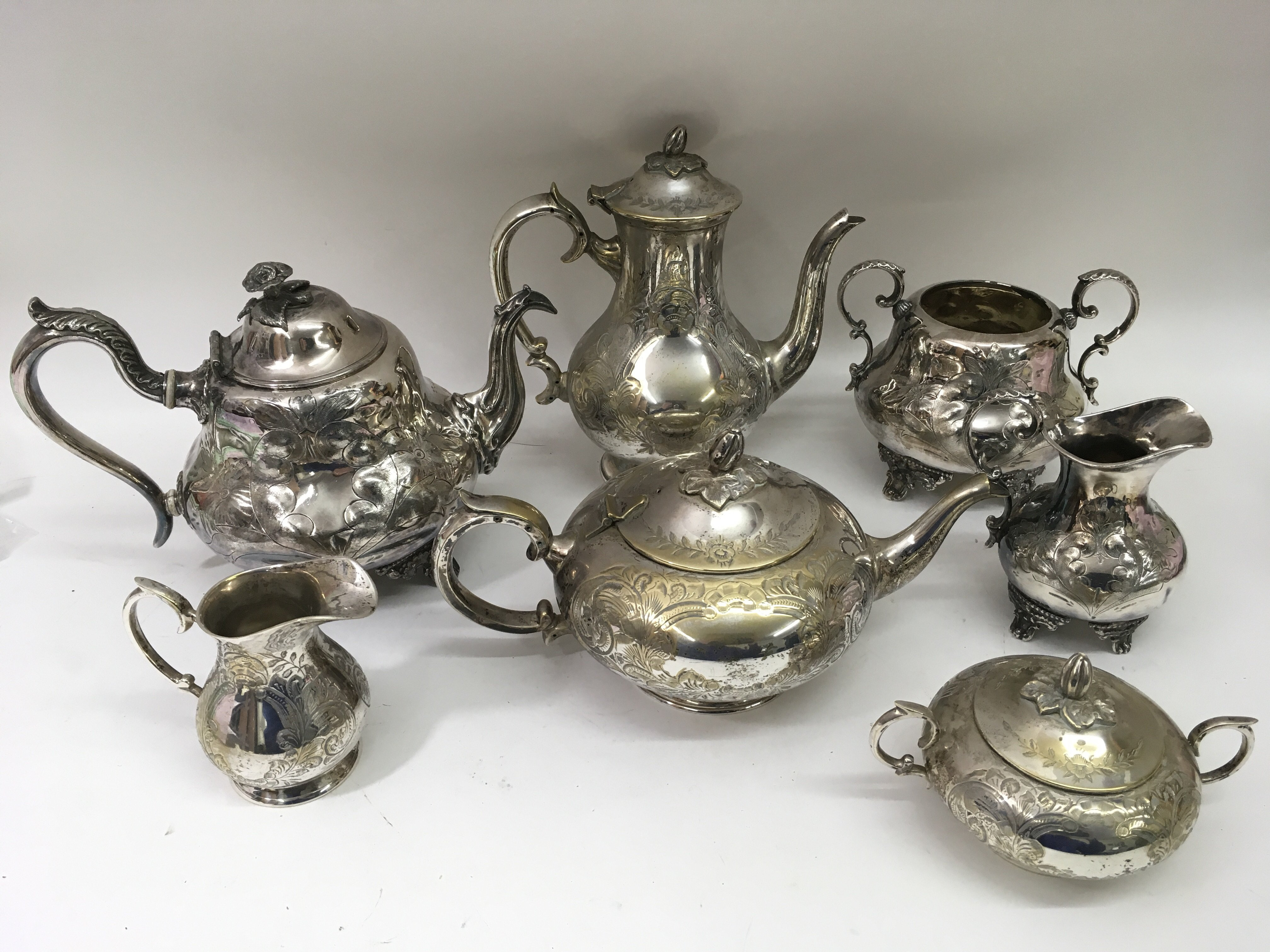 Lot 395 - Two, silver plated engraved teasets