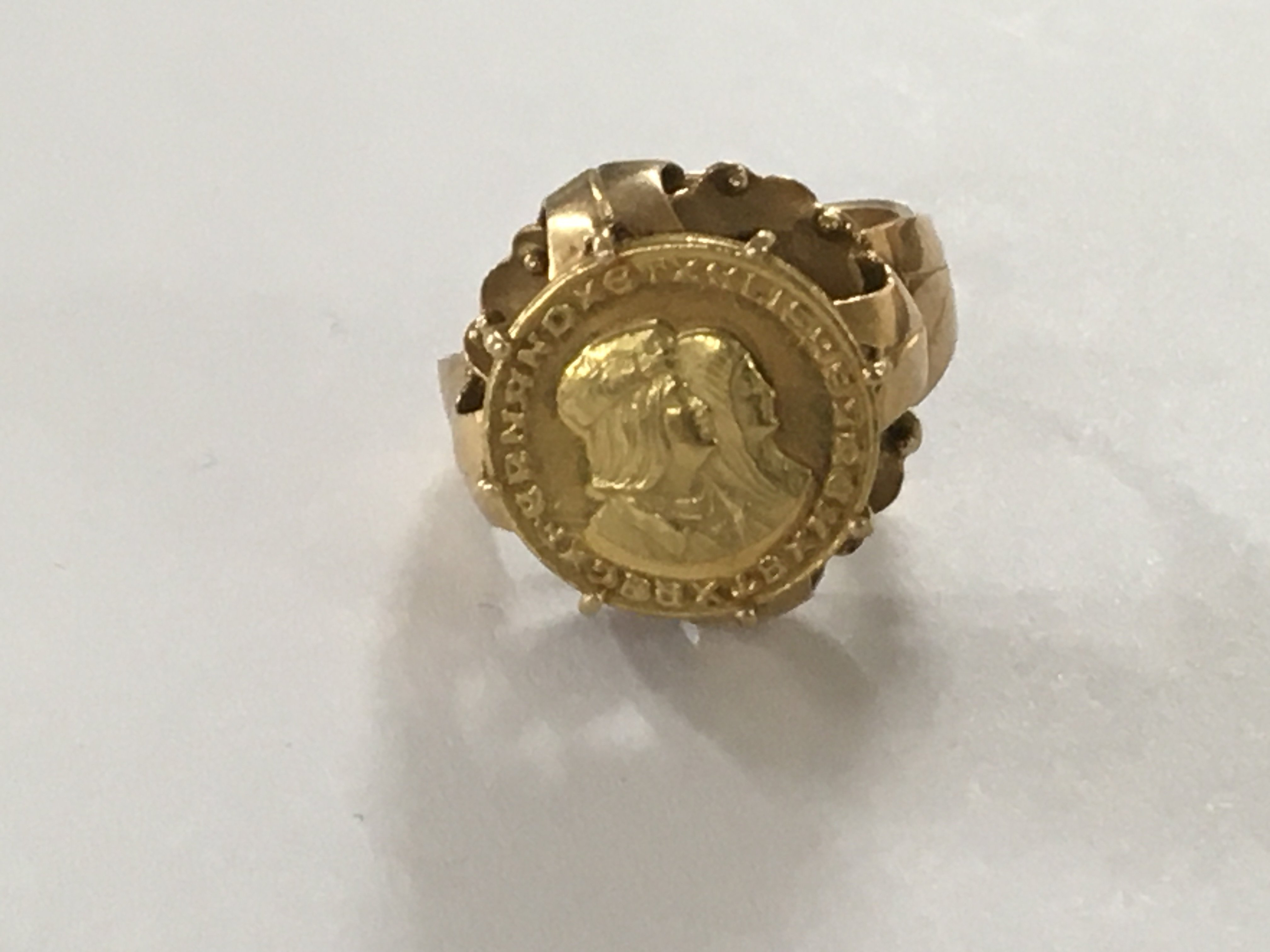 Lot 295 - A unmarked gold ring inset with gold ring size M