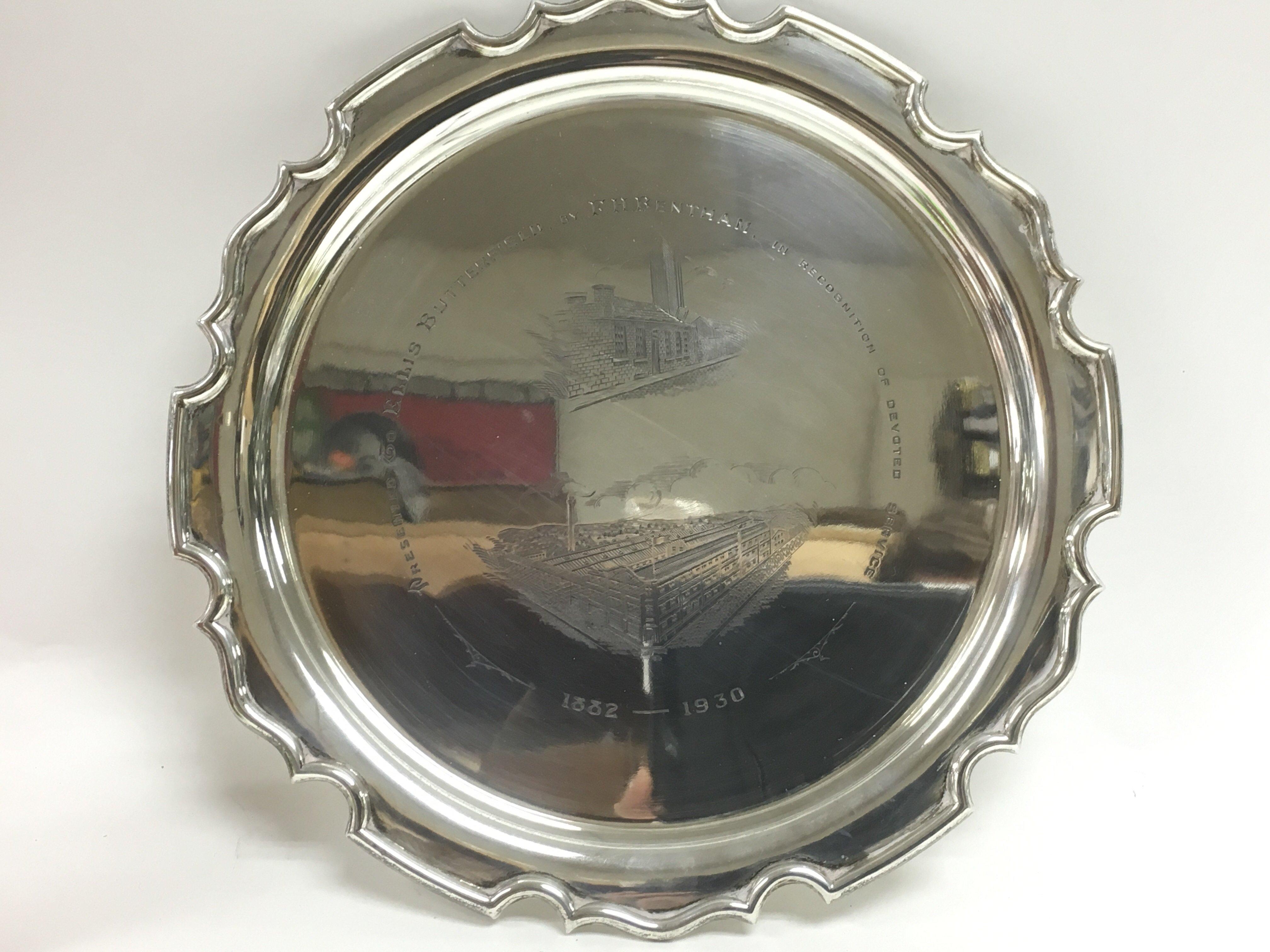 Lot 318 - A silver circular dish inscribed with a presentati